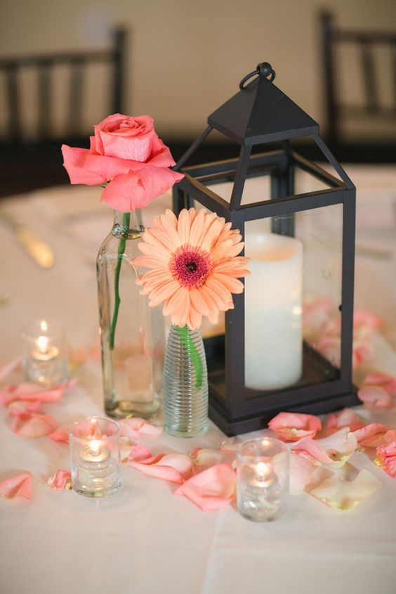 We're loving this Rustic centrepiece design; lanterns are a huge trend coming from 2018 into 2019. Adding rose petals is a stunning way to incorporate your main colours.   https://www.pinterest.ca/pin/473440979555454089/ `