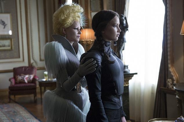 "Effie Trinket (Elizabeth Banks, left) and Katniss Everdeen (Jennifer Lawrence, right) in ""The Hunger Games: Mockingjay – Part 2."" Photo Credit: Murray Close."
