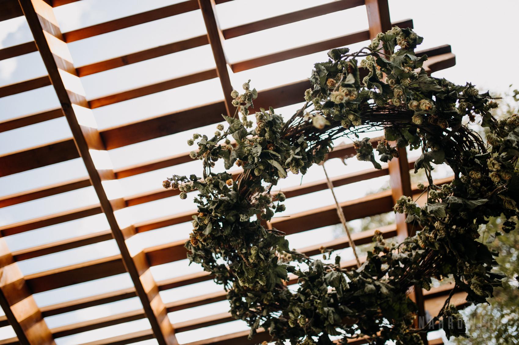 backyard-summer-farm-wedding-greenery-arch-large-lanterns-33.jpg