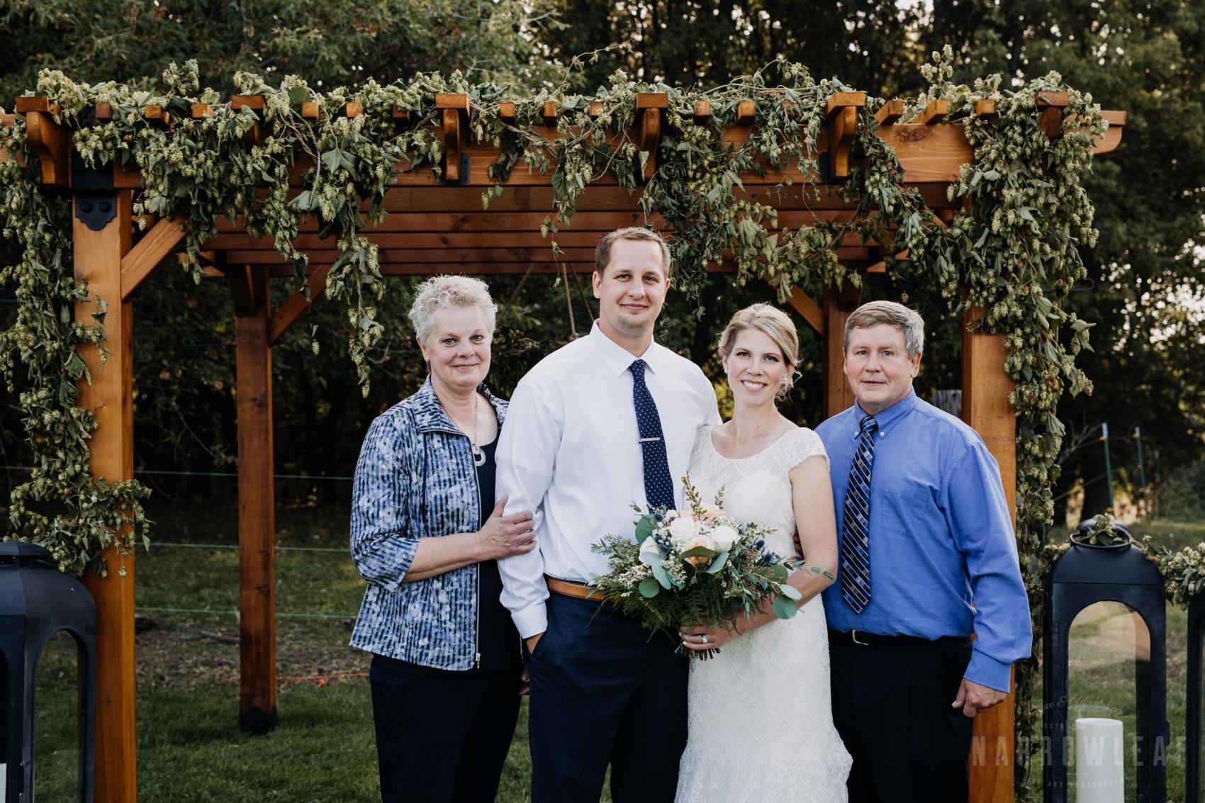 outdoor-summer-wedding-arch-family-photos-32.jpg
