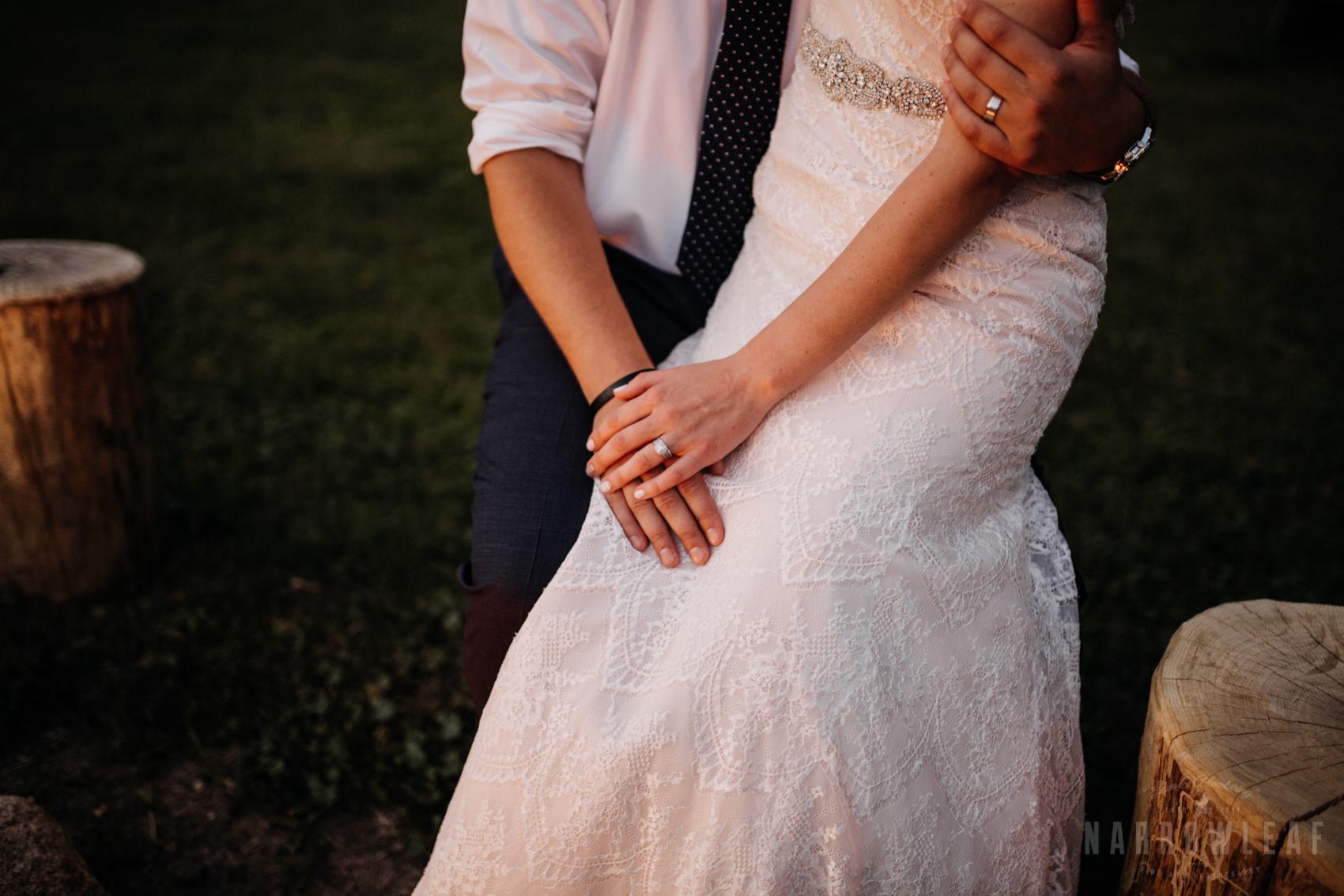 bride-groom-cuddling-by-the-bonfire-under-cafe-lights-night-34.jpg