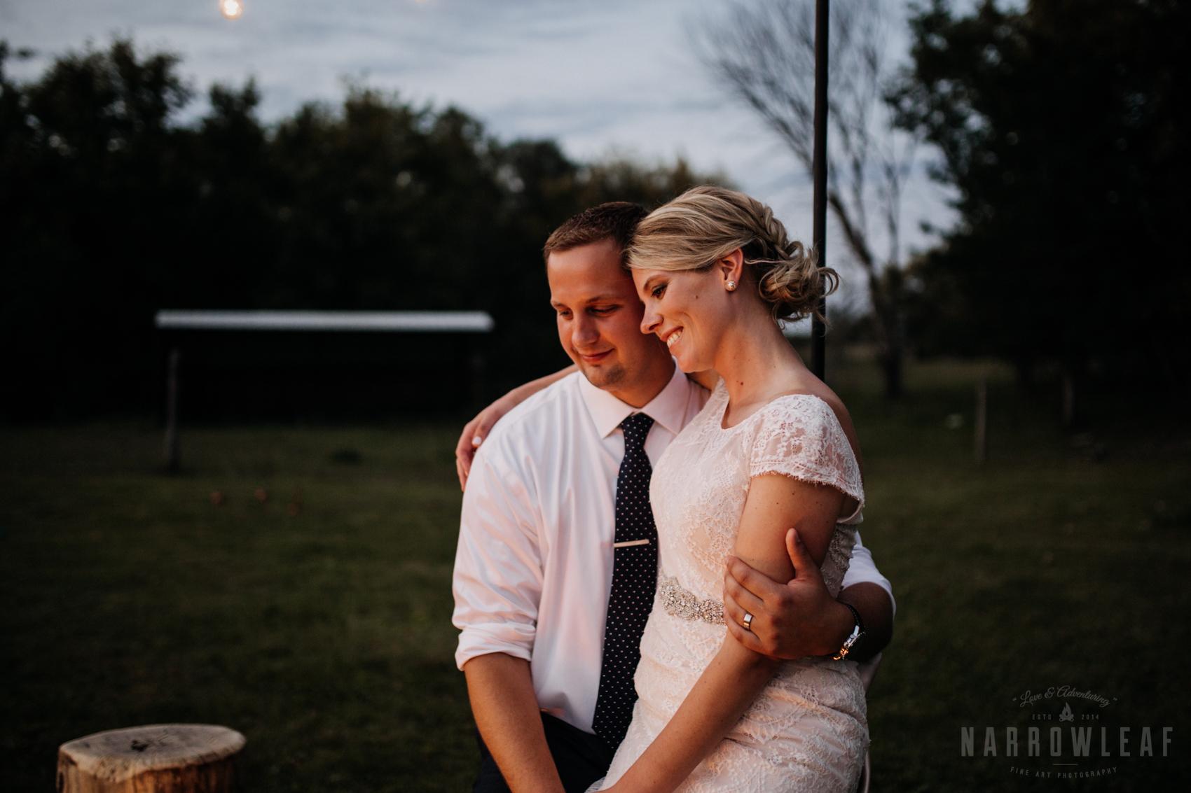 bride-groom-cuddling-by-the-bonfire-under-cafe-lights-night-35.jpg