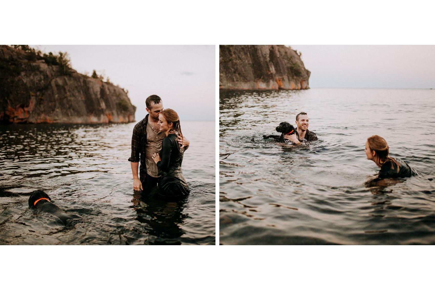 Adventurous engagement photos of couple in lake Superior