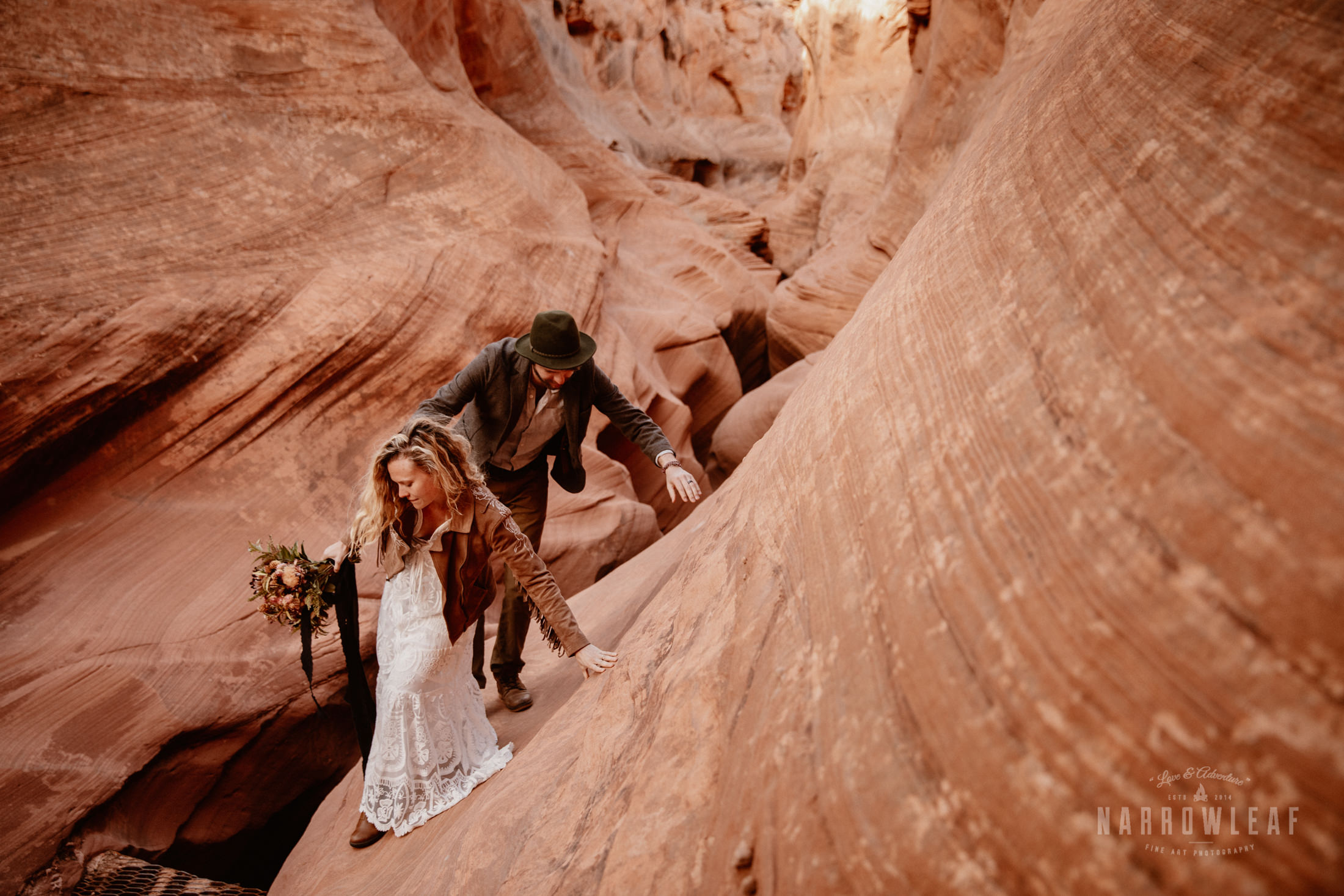 adventure-elopement-photography-in-Page-Arizona-climbing-canyon.jpg
