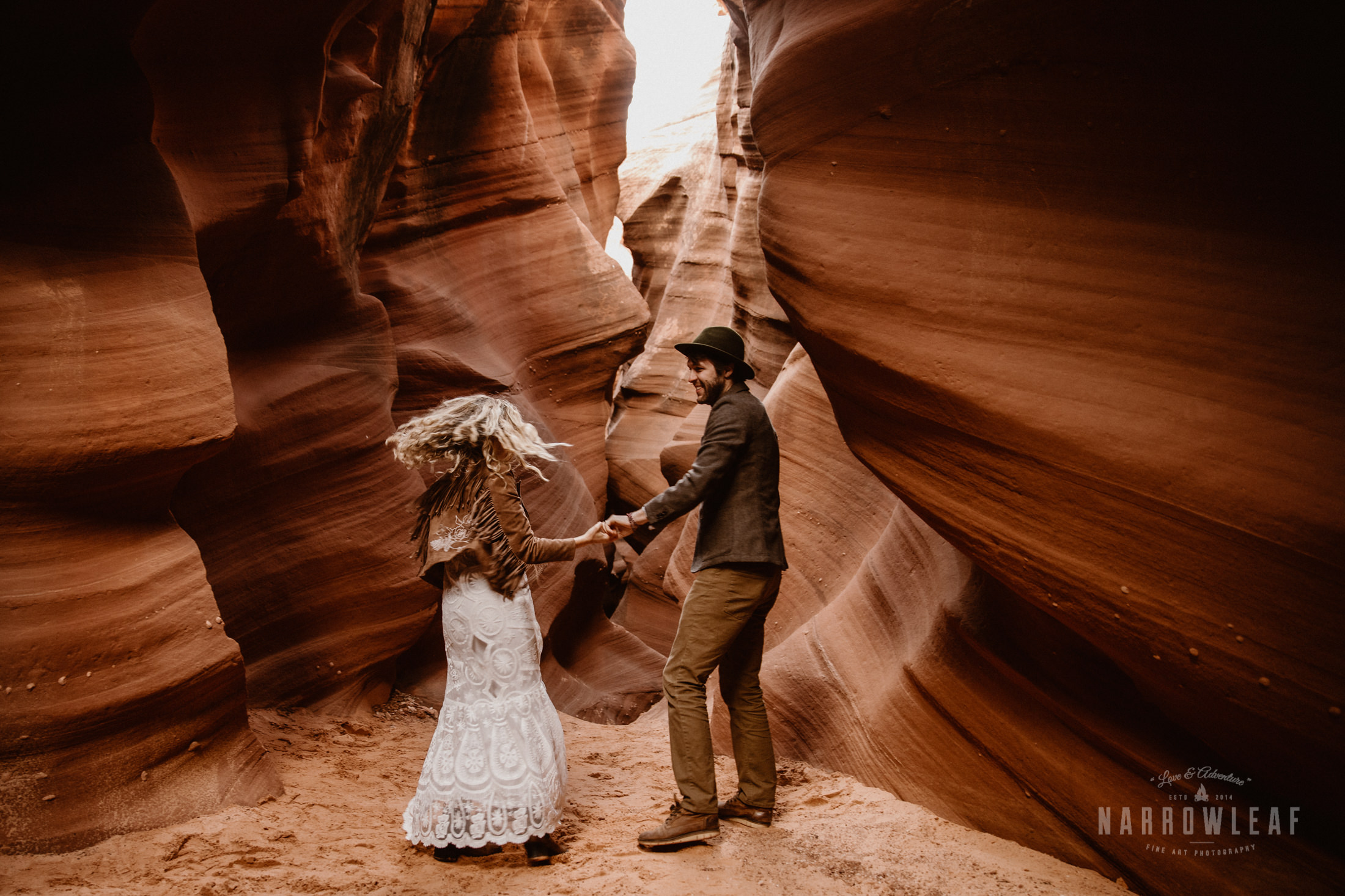dancing-bride-and-groom-in-slot-canyon.jpg