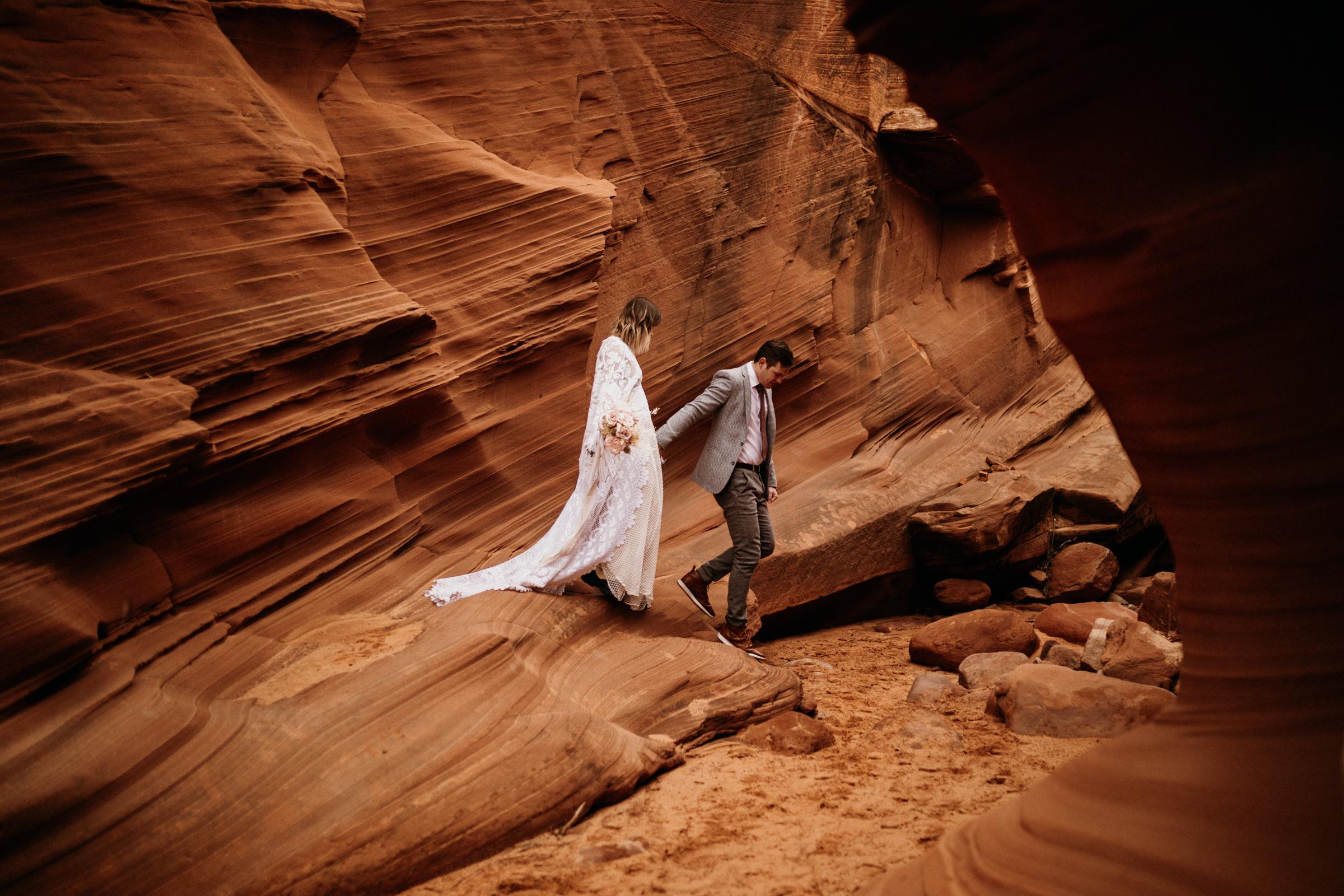 bohemian-styled-elopement-wedding-walking-through-canyon.jpg