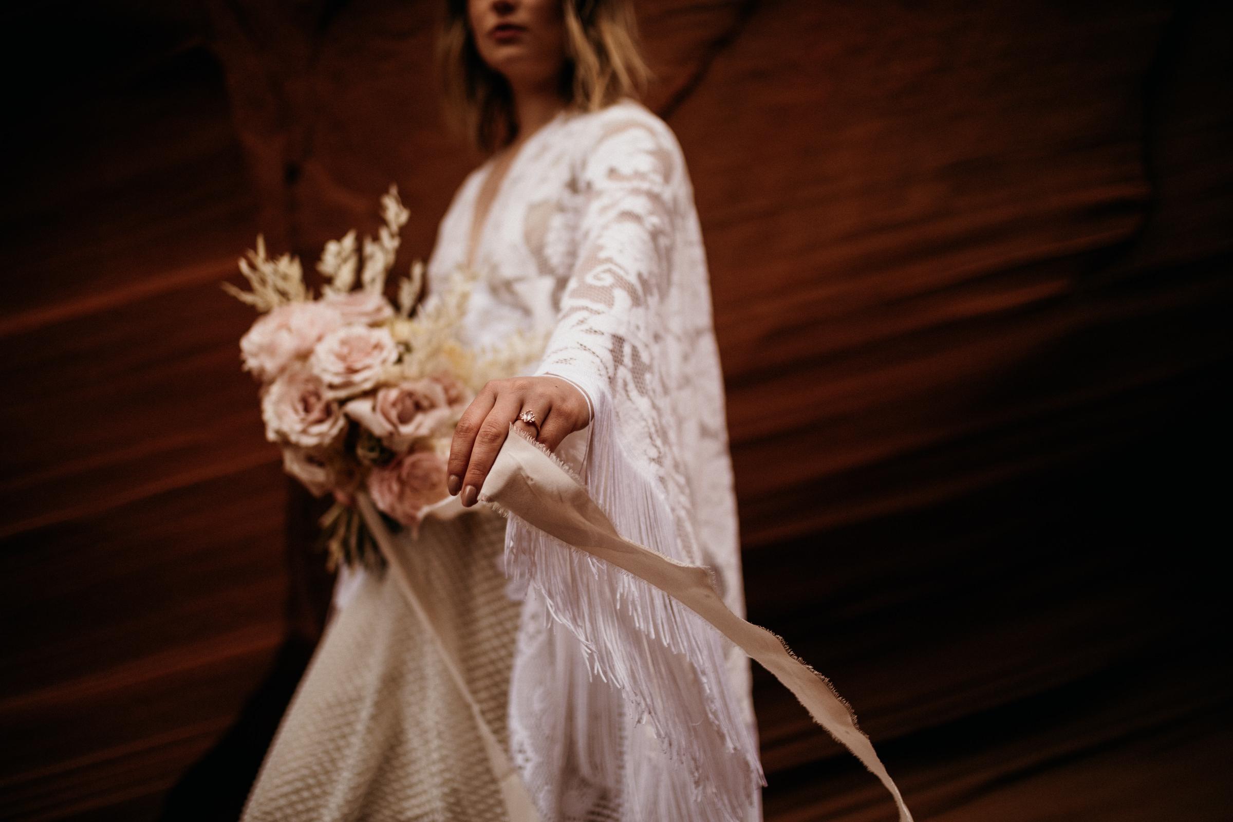 details-of-boho-bride-in-fringe-wedding-dress.jpg