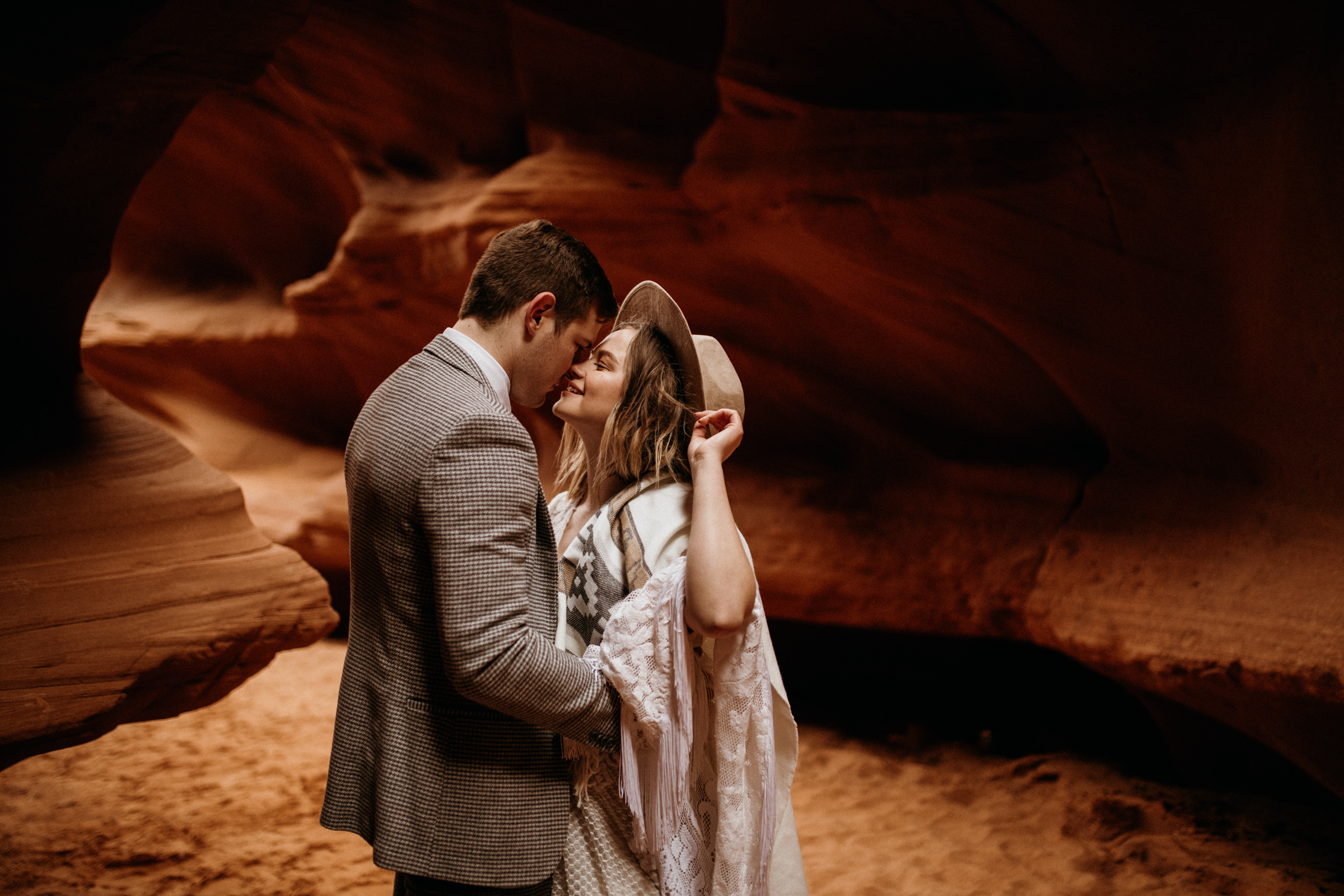 hipster-adventure-photographer-in-slot-canyon.jpg