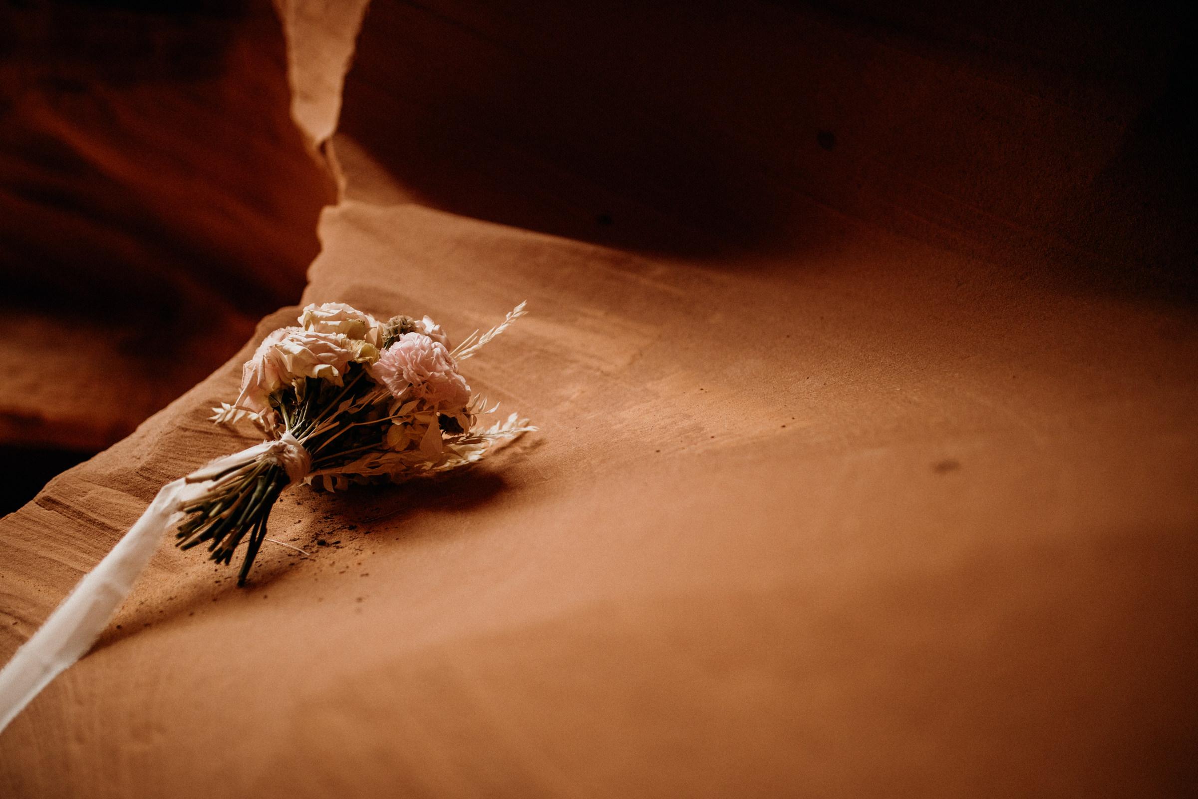 elopement-bouquet-on-slot-canyon-wall.jpg