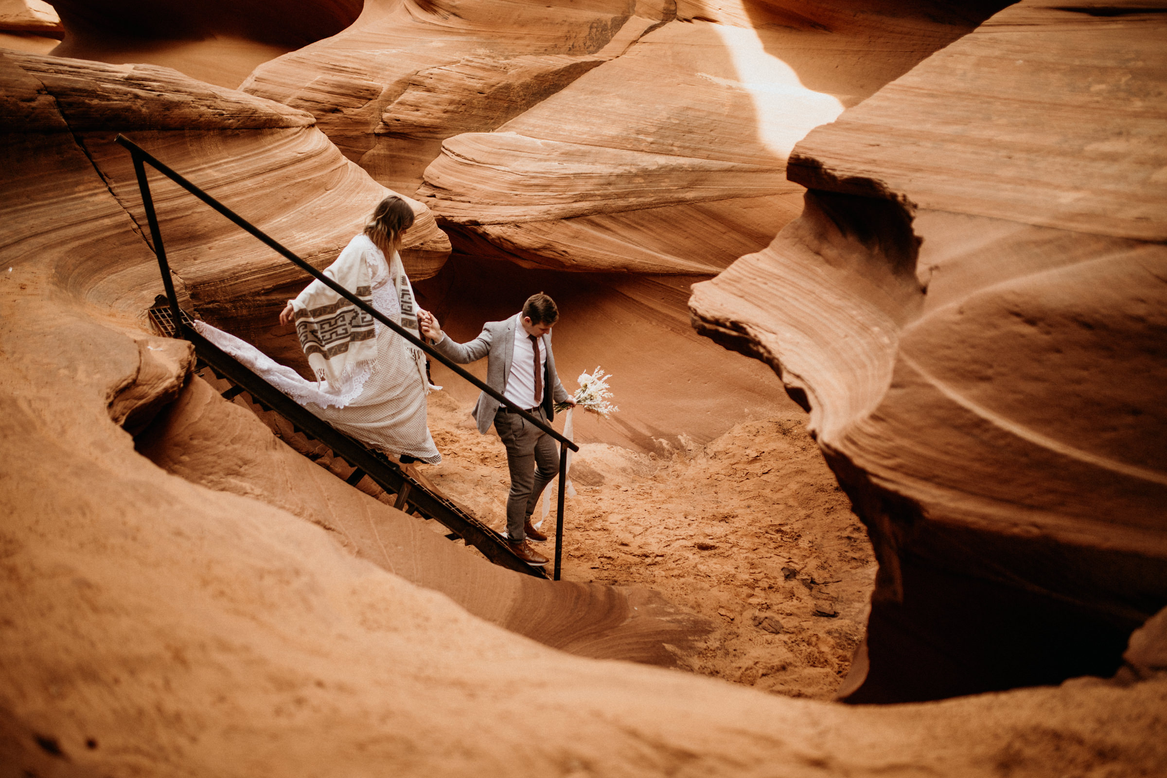 couple-hiking-adventure-in-the-slot-canyon.jpg