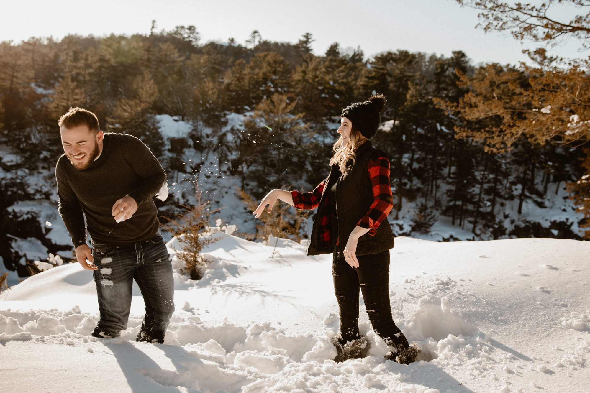 snowball-fight-during-an-engagement-photoshoot.jpg