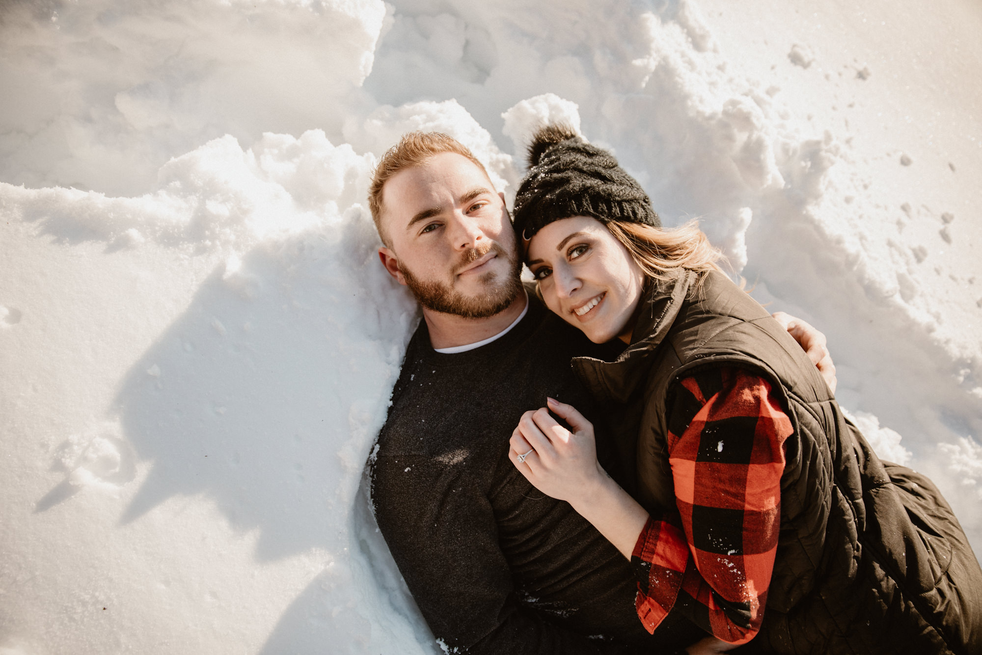 couple-laying-in-snow.jpg