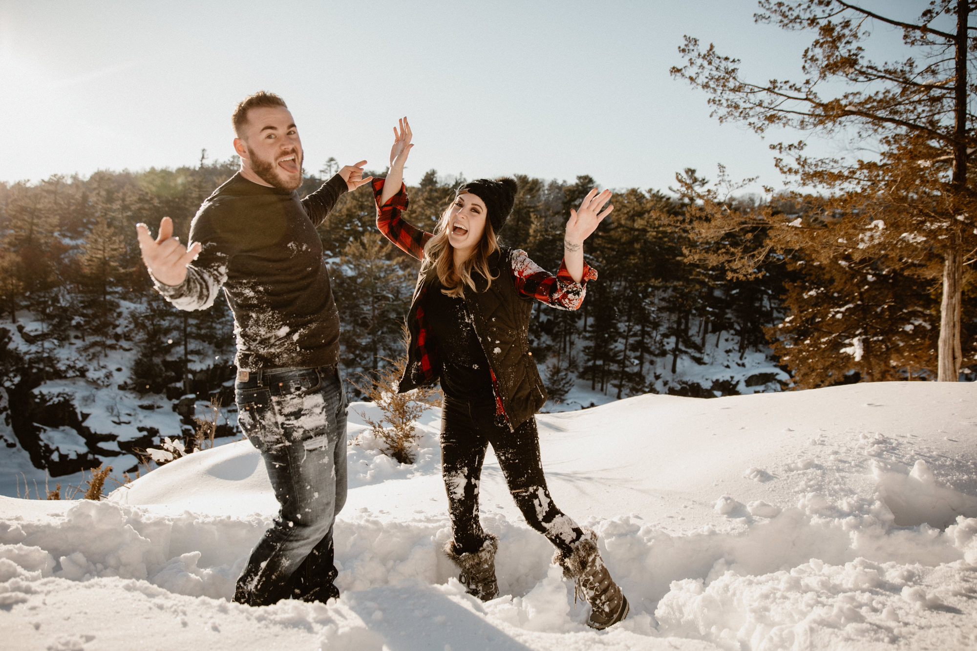 adventurous couple playing in the snow