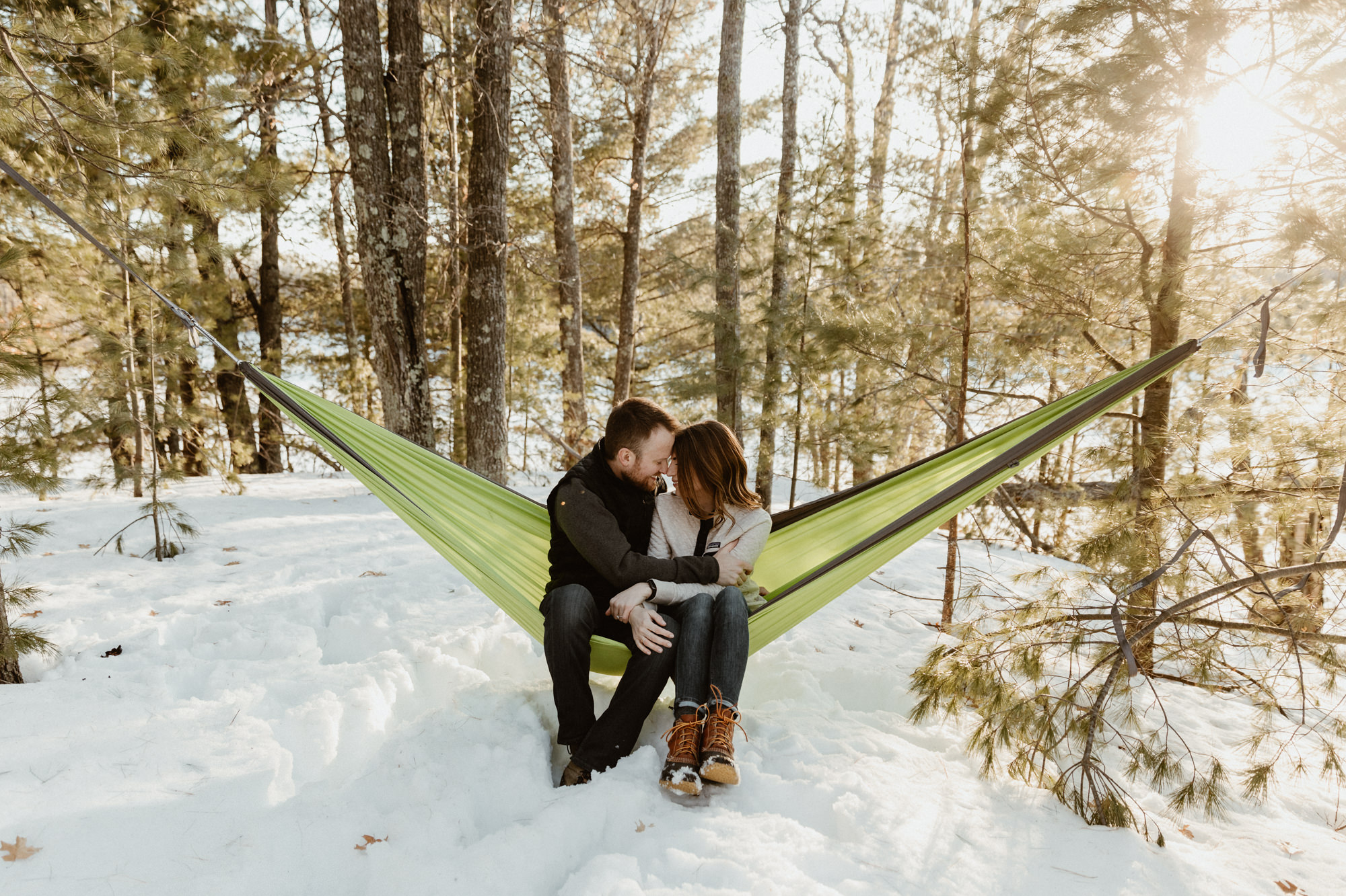 Adventurous couple hanging in a hammock for their adventure engagement photos.