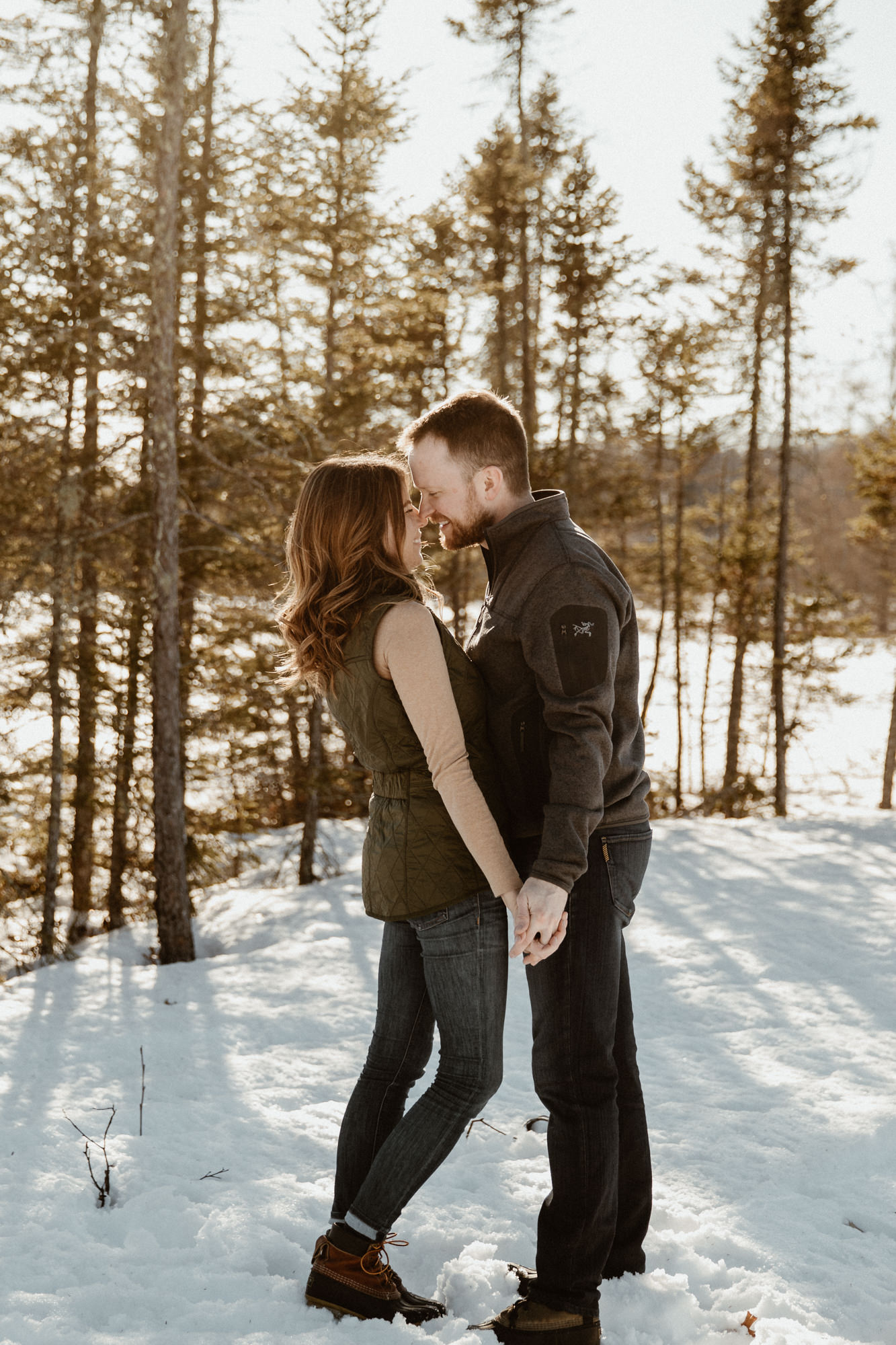 Authentic moment during a Wisconsin engagement session in the snow.