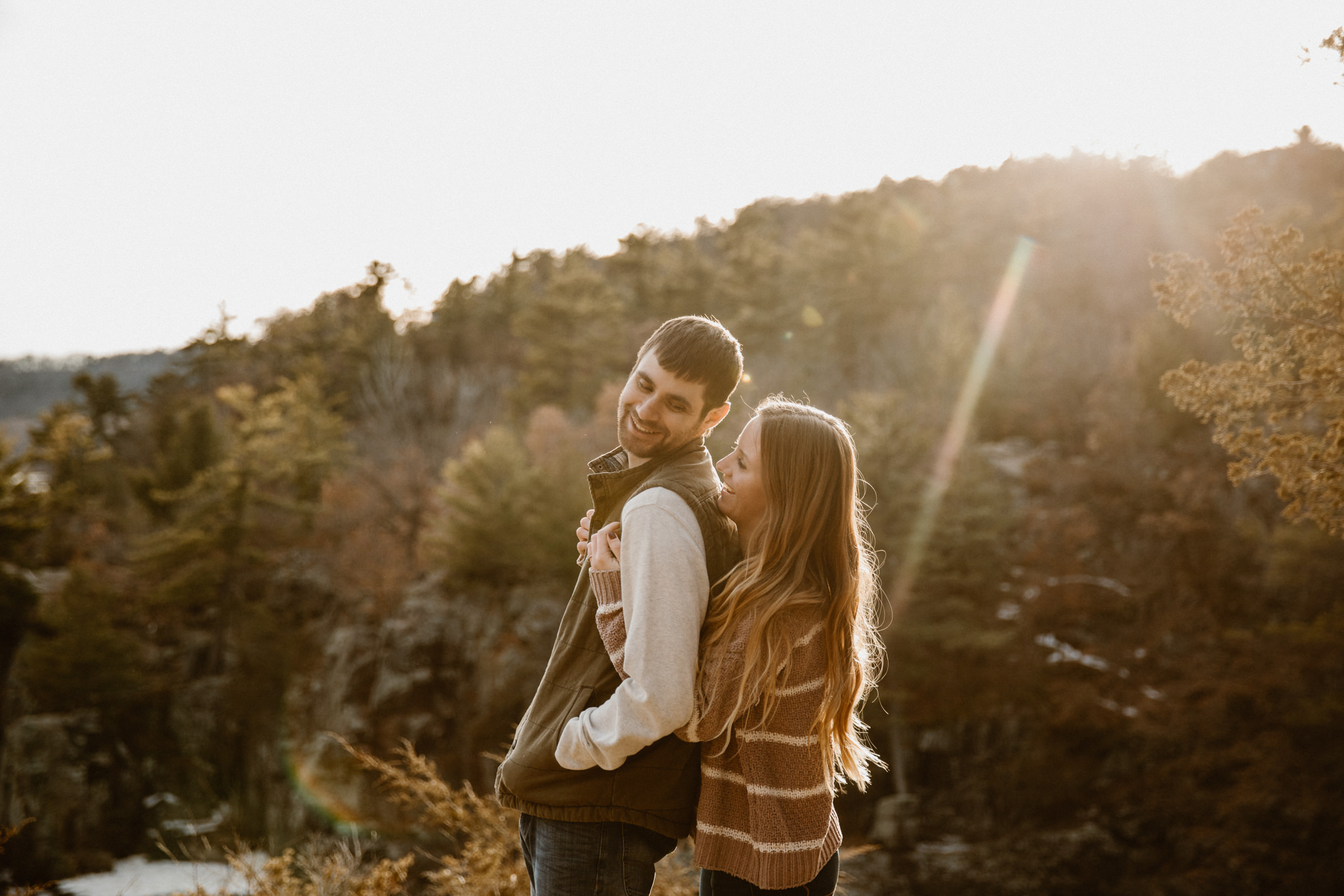Hiking adventure engagement photographers in Wisconsin