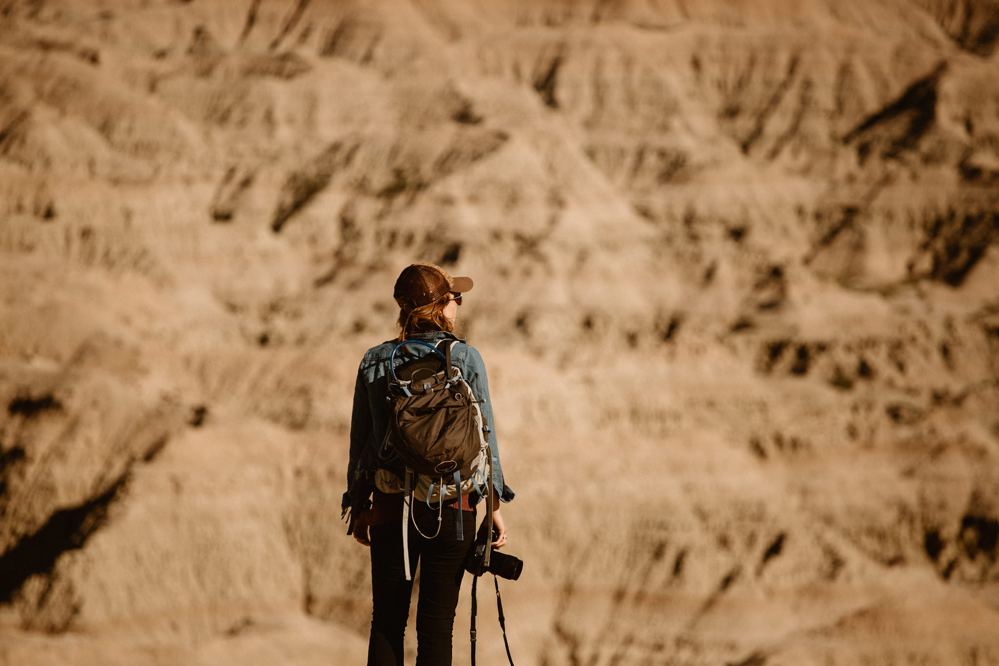 adventure-elopement-photographer-hiking-in-the-badlands.jpg