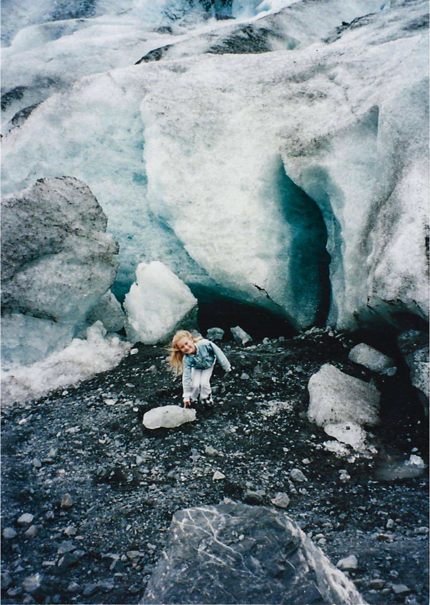 Me touching a piece of glacial ice in Alaska when I was 7!