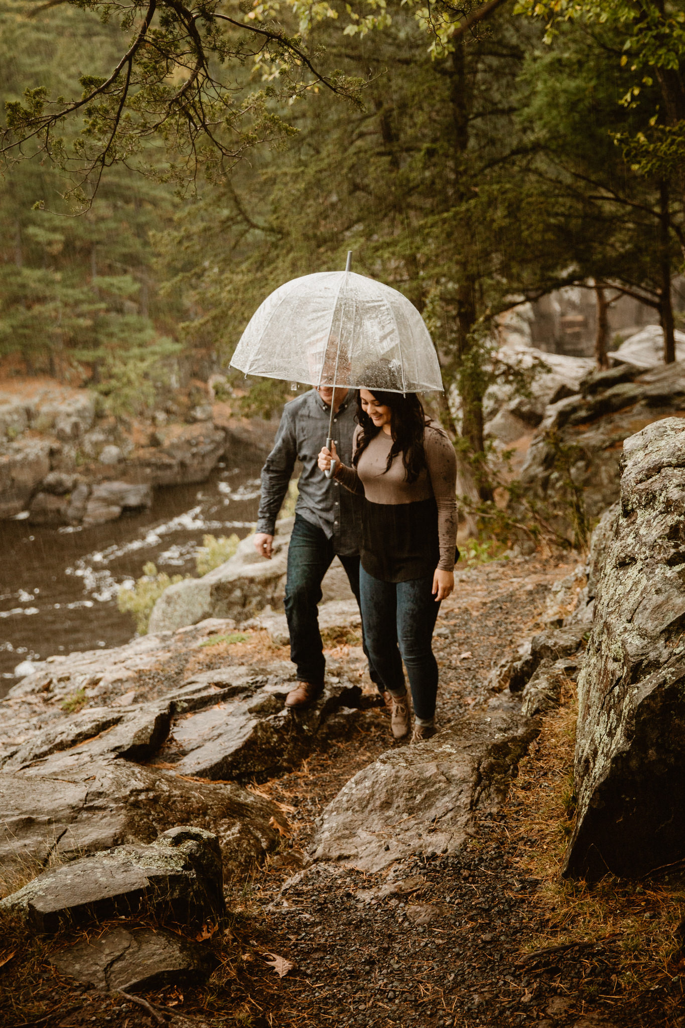 Wisconsin engagement photos hiking in the rain at Interstate Park.
