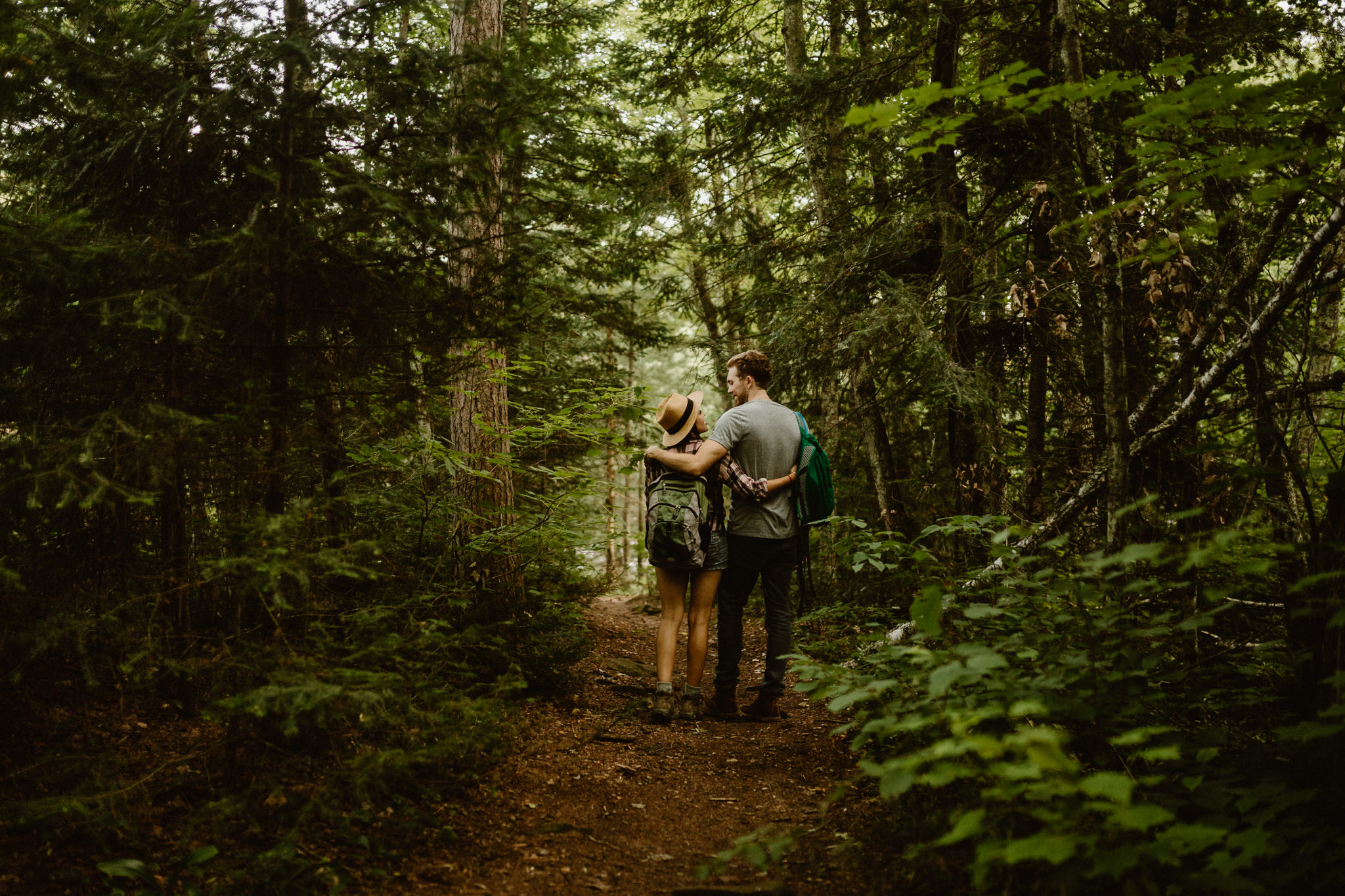 Minnesota engagement photography | couple hiking through the north woods at Banning State Park