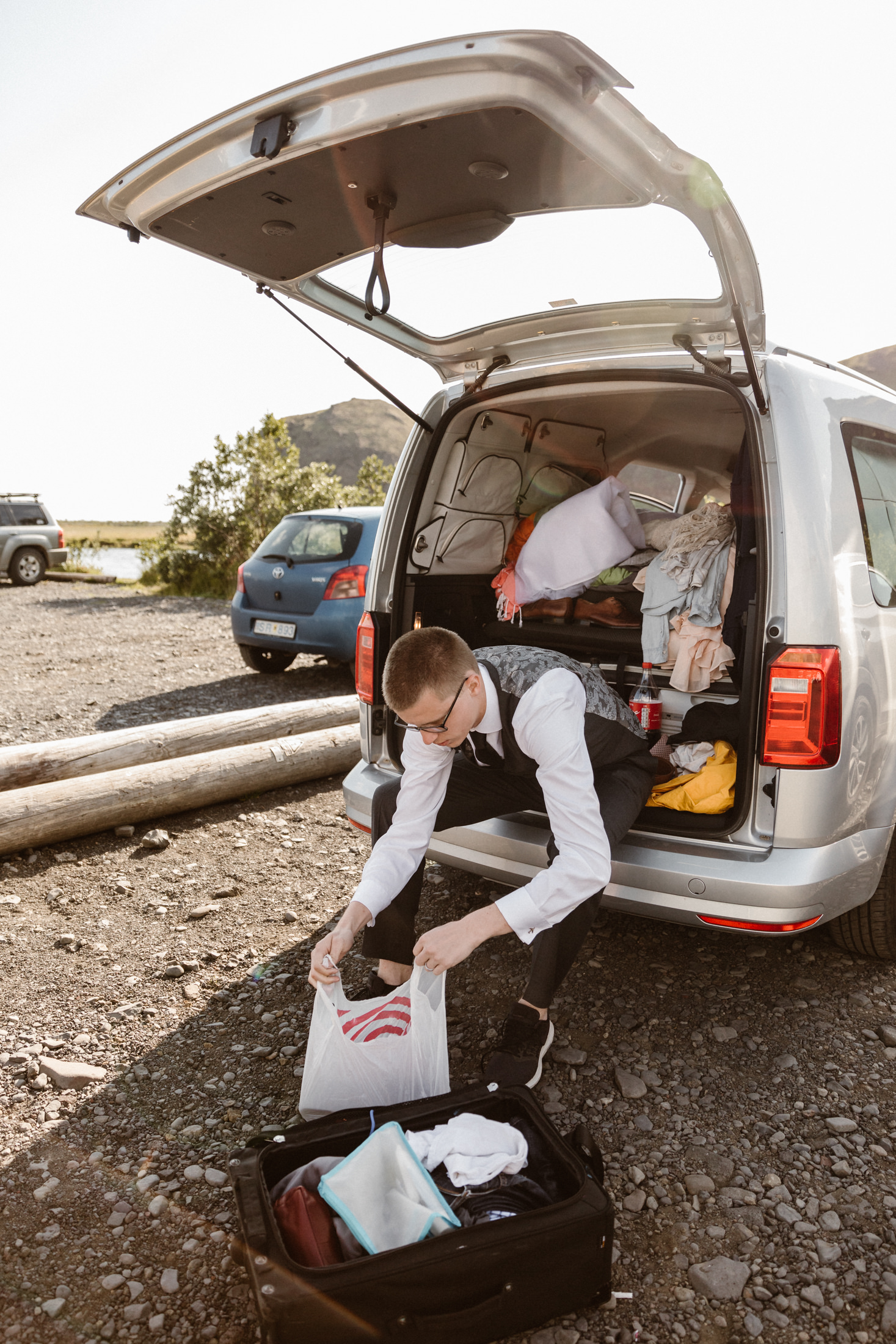 Groom getting ready for his wedding in a camper van in Iceland.