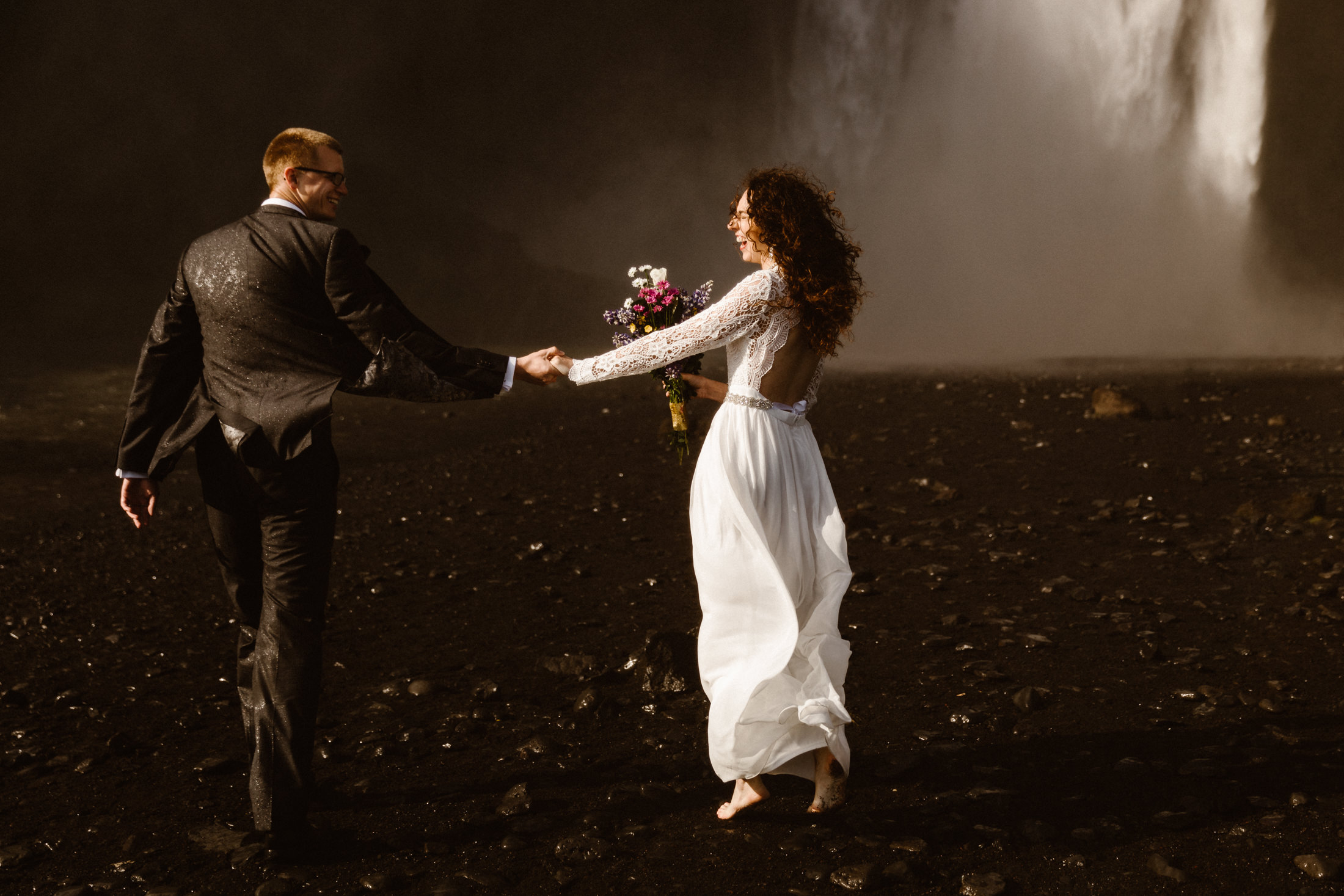 Couple eloped in Iceland by a waterfall.