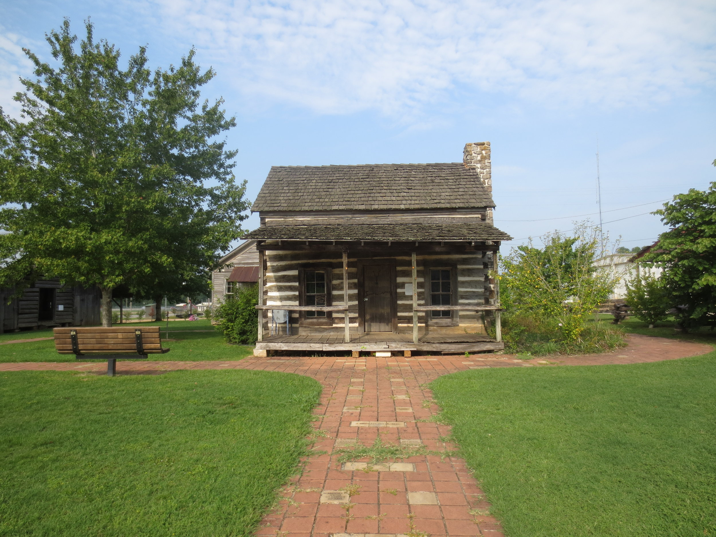 The Pioneer Cabin and the Donation Walk at the Heritage Homestead