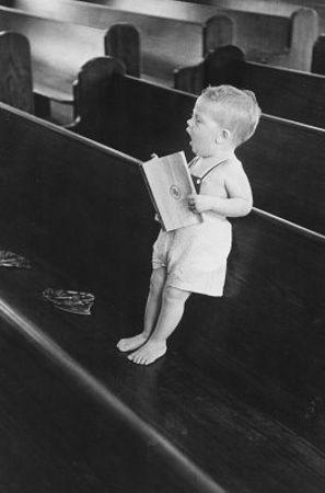 Kid standing on pew.jpg