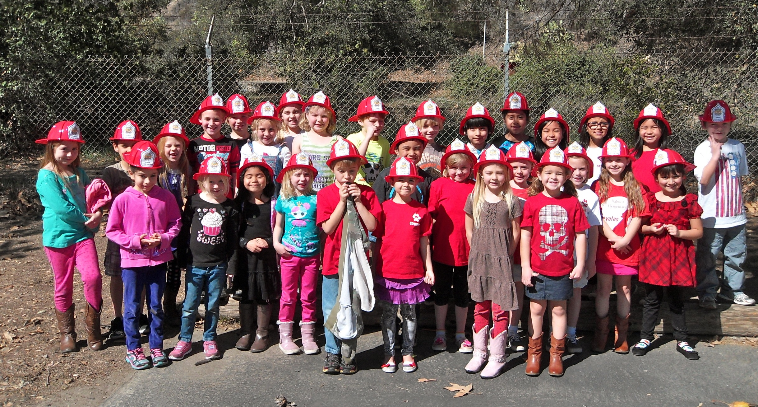 There might be more than one future fire fighter in this crew!