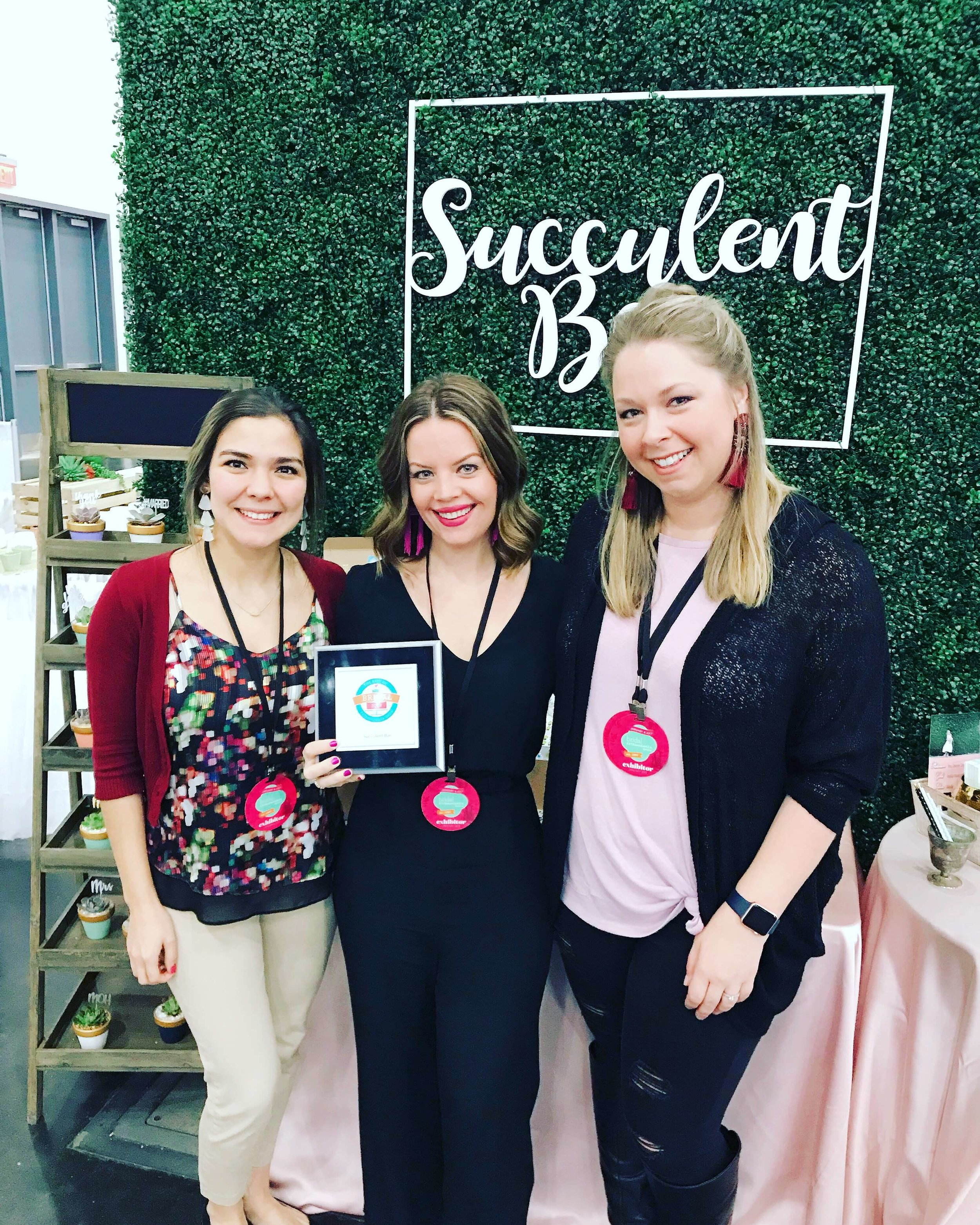 Jessica Siefert (center) accepting the Best of Bridal - Wedding Favors at 2018 Bridal Extravaganza
