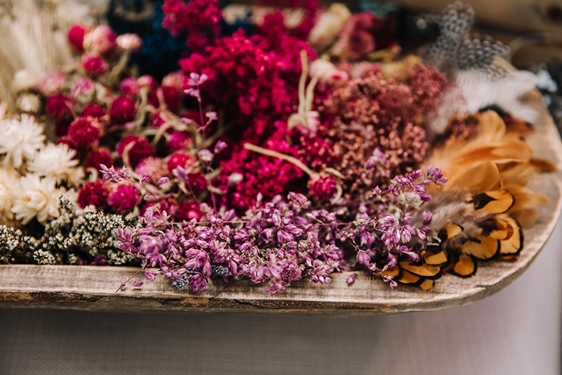 The dried floral we use is carefully preserved to retain its' original textures and stunning colors. No plastic or silk here.