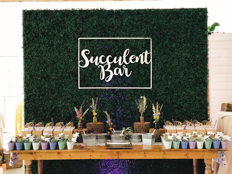 Faux greenery backdrop from  Exquisite Details by Raquel