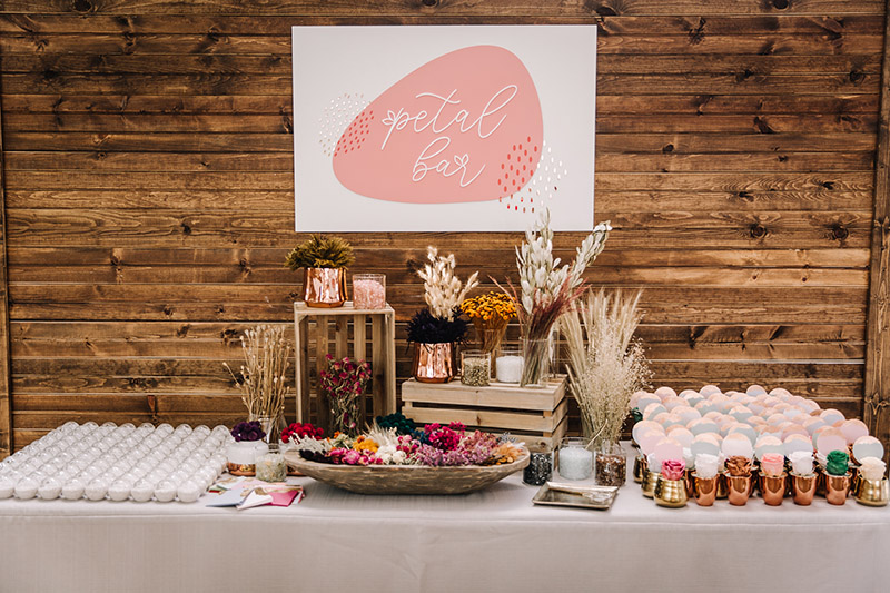 Our preserved roses and sand filled globes make for a take home gift your guests will not soon forget! Let our onsite Petal Bar Specialist oversee our interactive table.