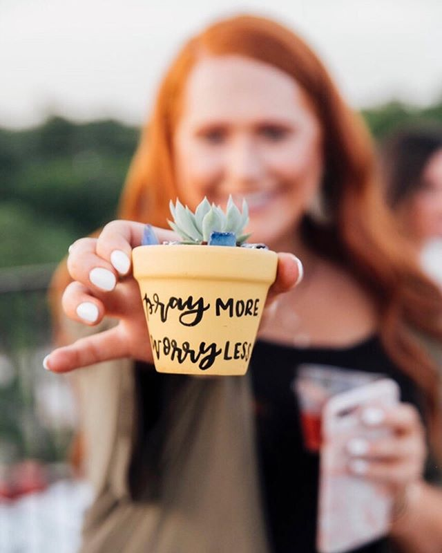 "This pot said ""Pray more, Worry less."" These are two things I need to tell myself every single day. I tend to worry and stress about everything (all the time) and really wish I knew how to be more laid back about things. One saying I do live by though is ""each day do your best and in God's hand leave the rest."" 🙌🏻⠀ ⠀ At this event for @kendrascott it was so fun to have a calligraphy artist onsite to hand paint guests custom text on the outside of their pot. It doesn't get more personalized than that! What would you want written on your personalized succulent container?✍🏻🔠🖌⠀ ⠀ Calligrapher: @jennimetz⠀ Venue: @RavenTower ⠀ Company: @KendraScott"