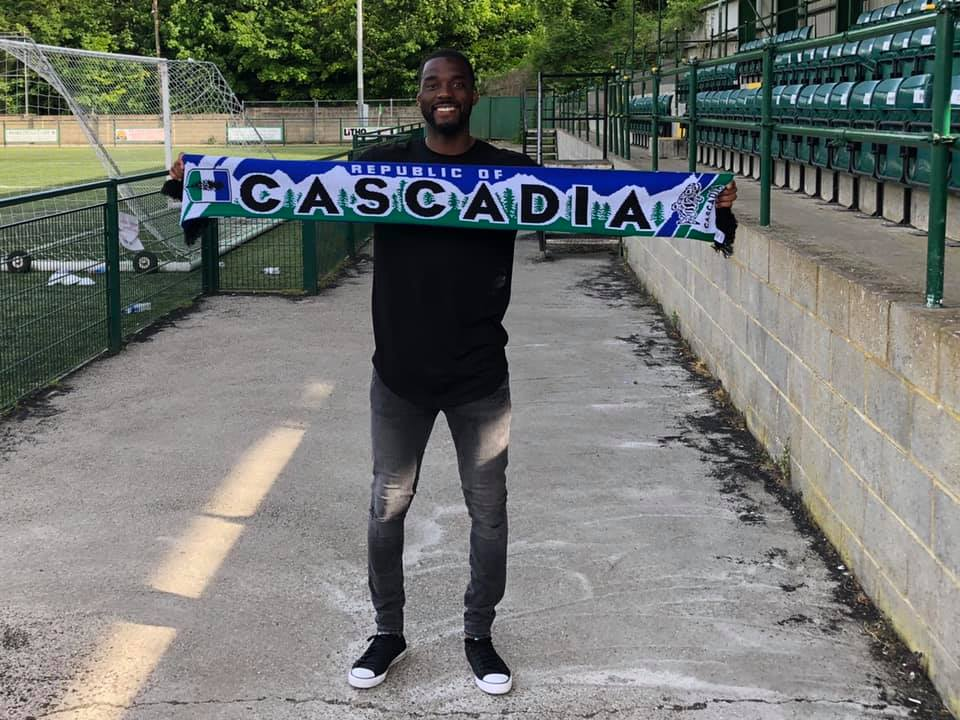 Team Captain Patrick Wilson holding his Republic of Cascadia Scarf.