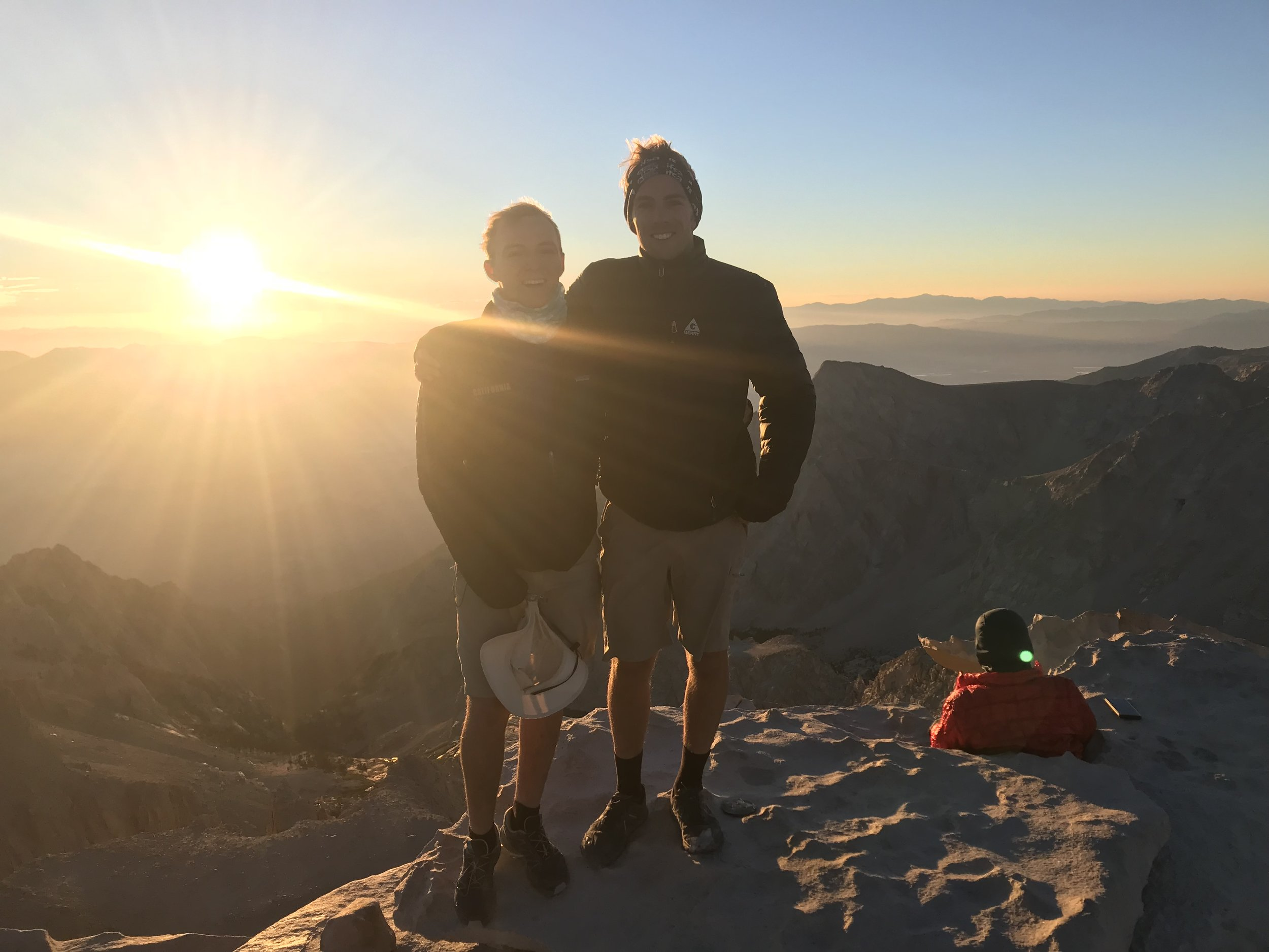 Brothers at sunrise, featuring random stranger in background.