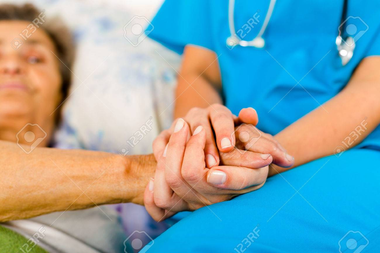 nurse-holding-senior-hands-in-caring-attitude.jpg