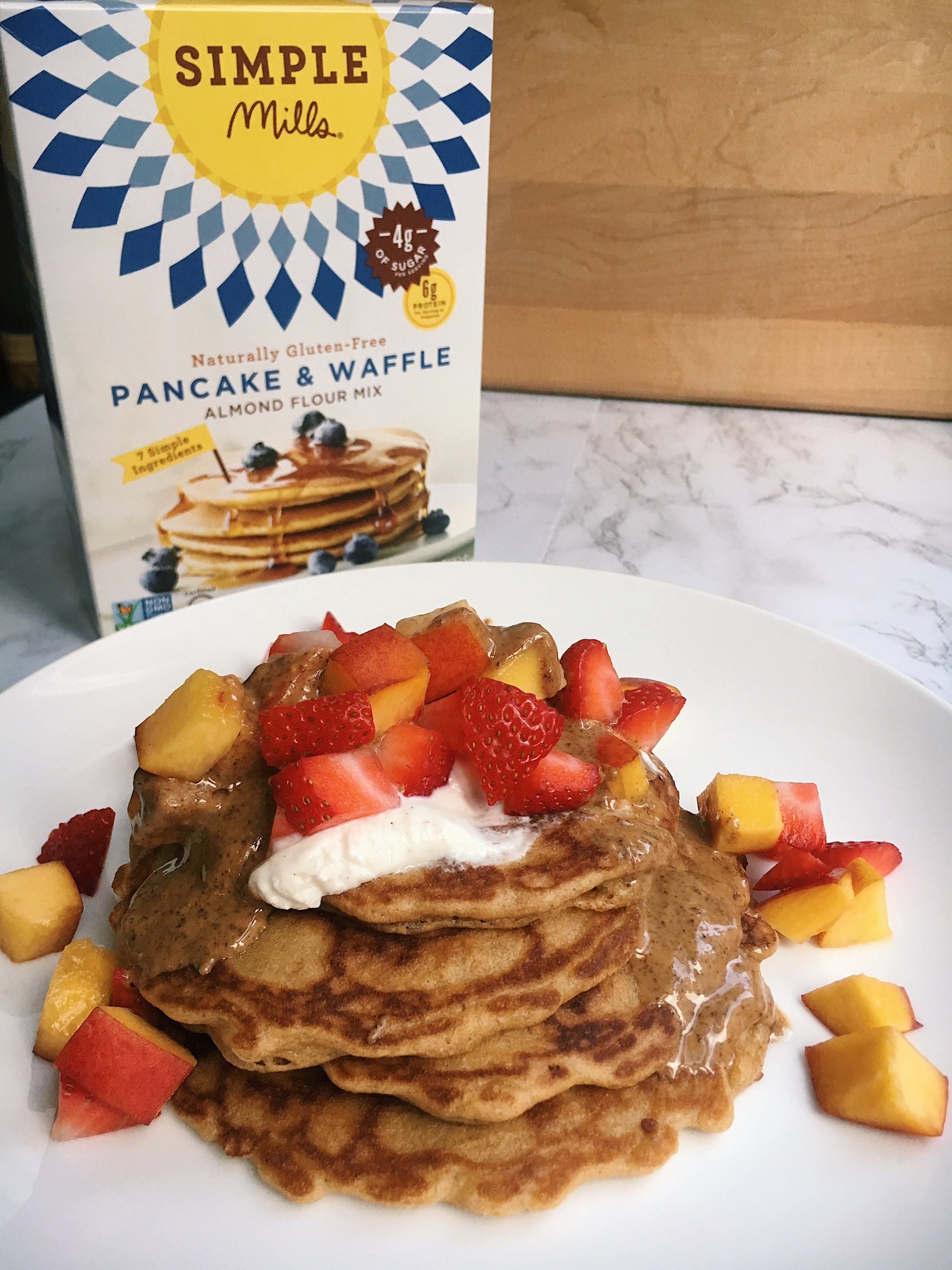 simple mills july blog pancakes with full box.jpg