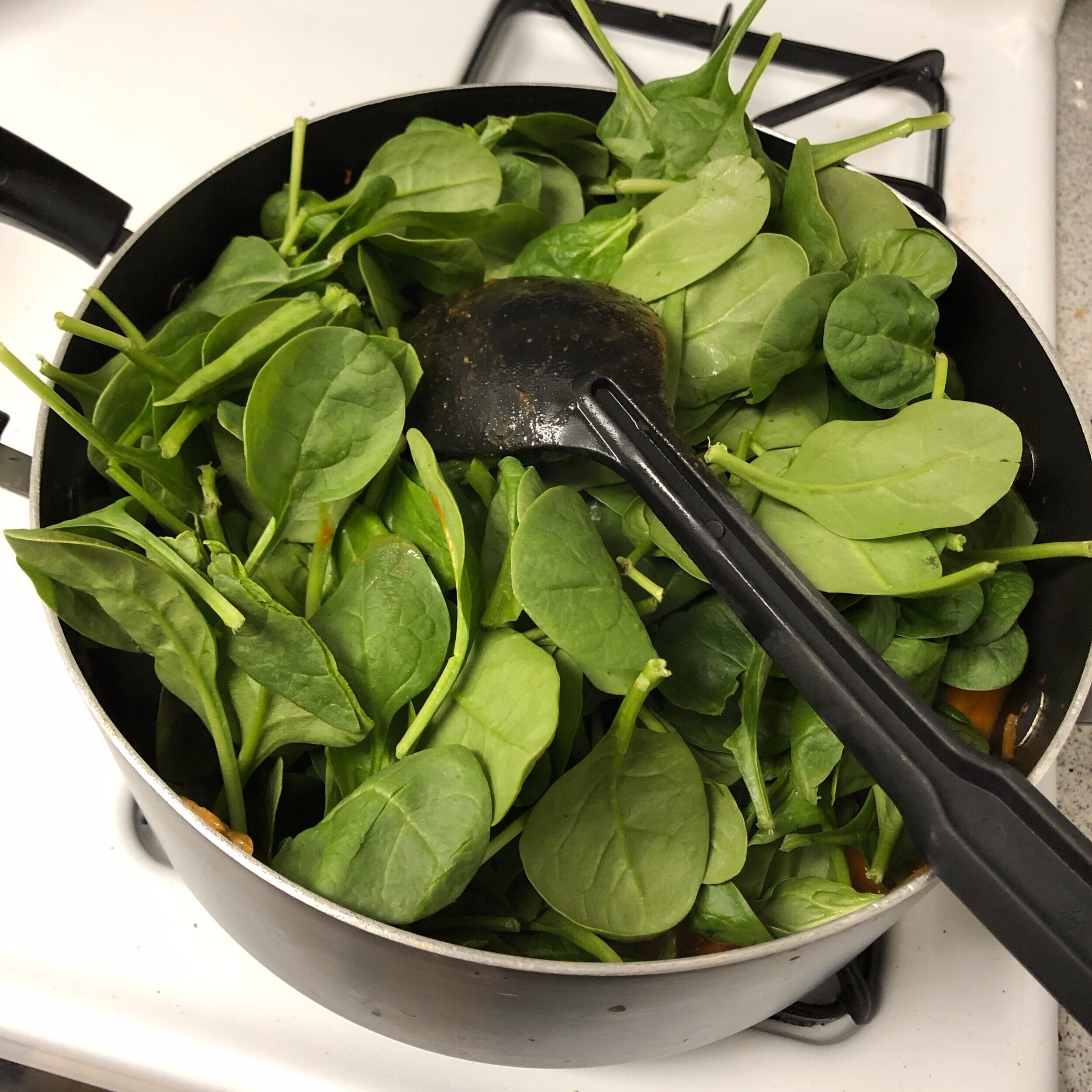 Step 6: The spinach will take up a ton of room at first, but it will cook down within about 5 minutes.