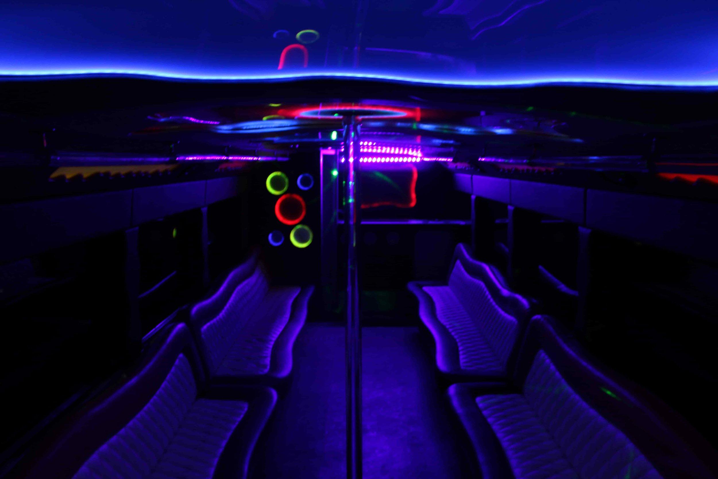 Patriot Limo Bus with a dark light glow
