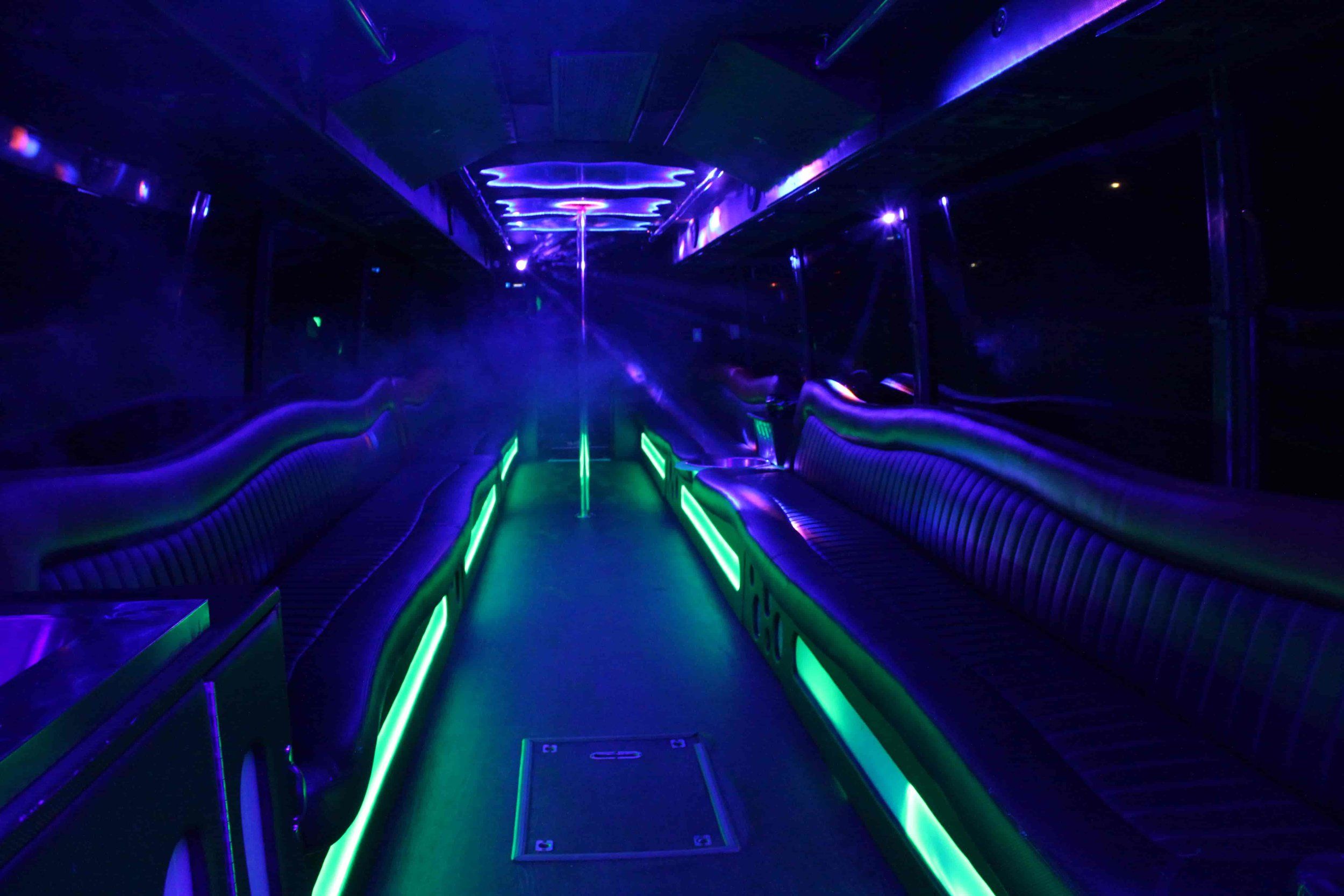 47 Passenger Patriot Limo Bus with a under lit diffusion from fog machine