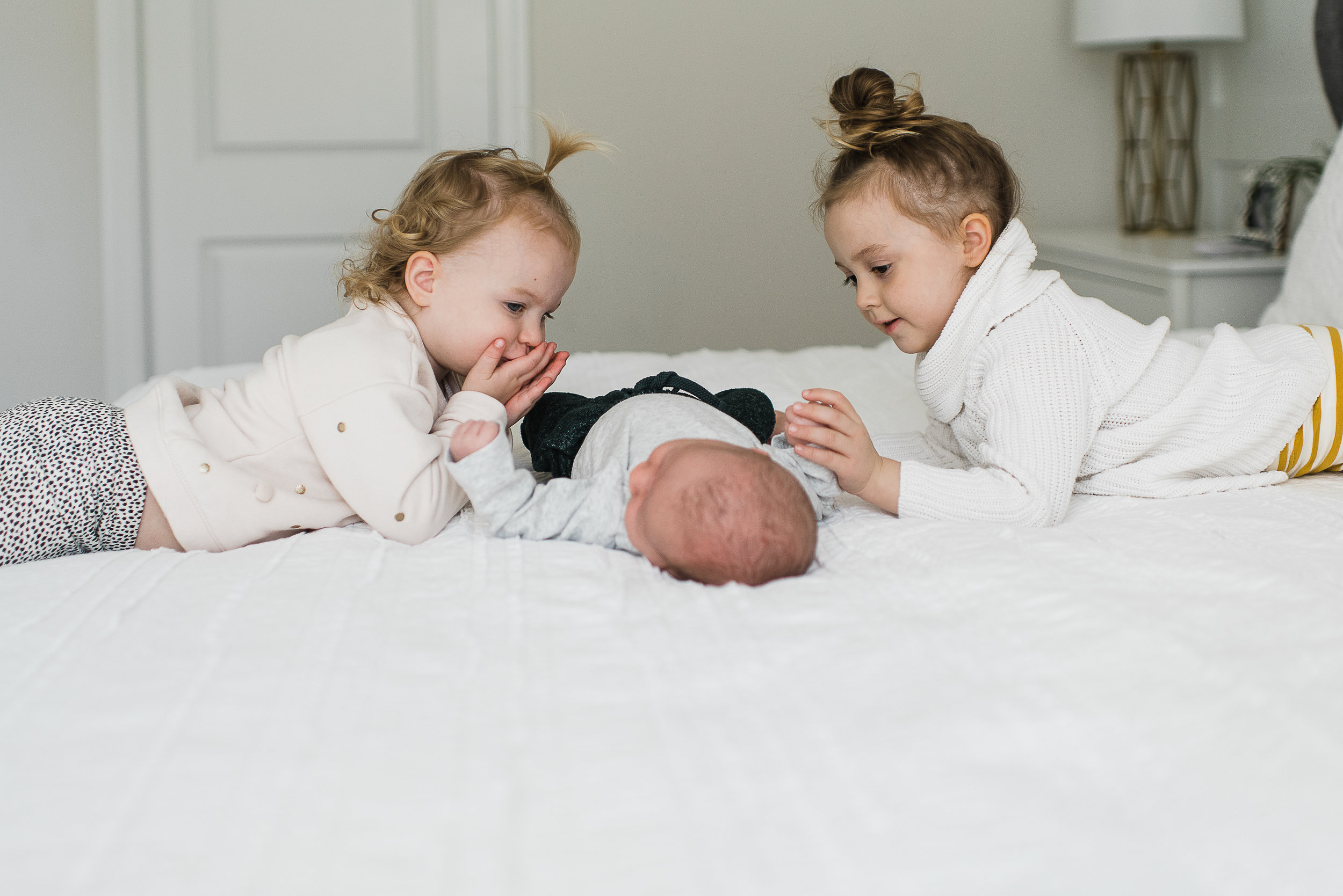 big sisters with new baby