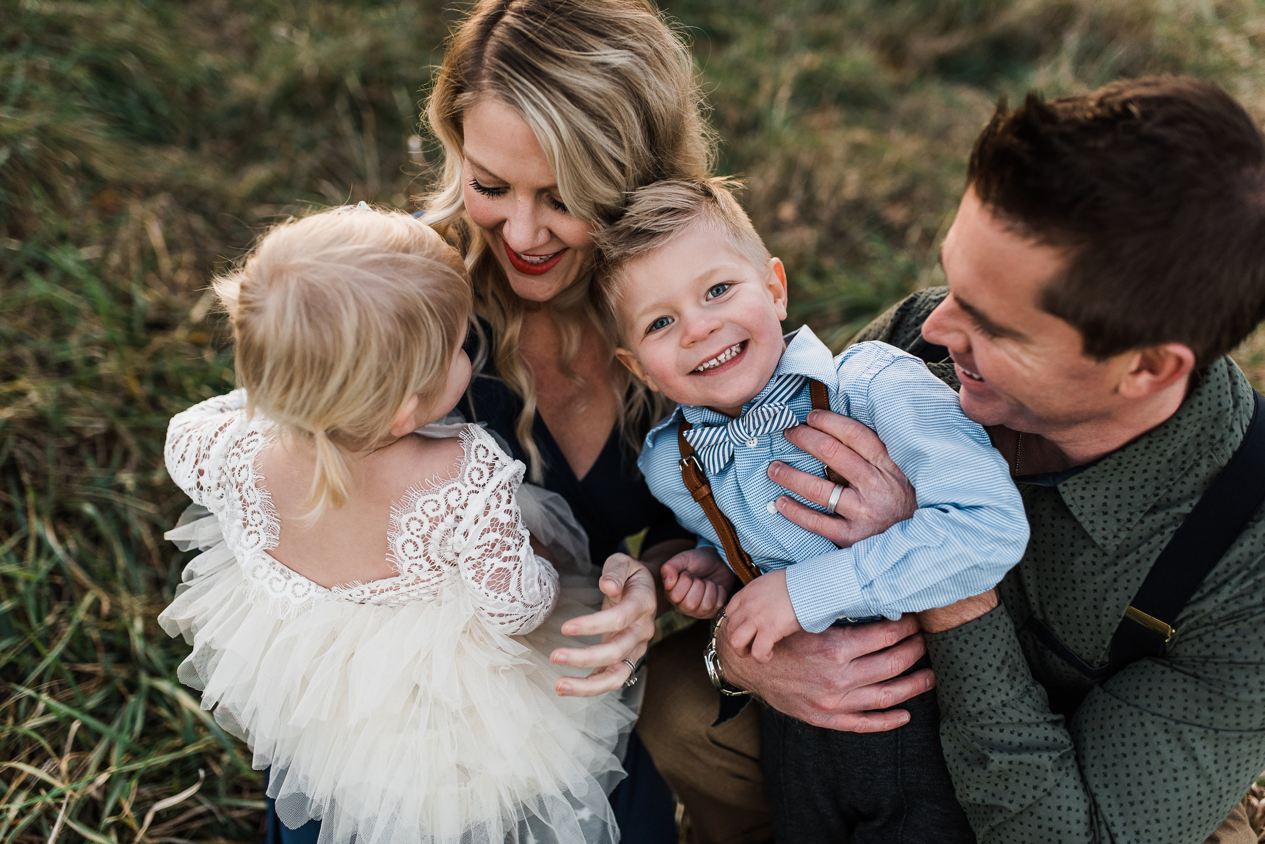 little boy laughing with family St. Louis Family photographer