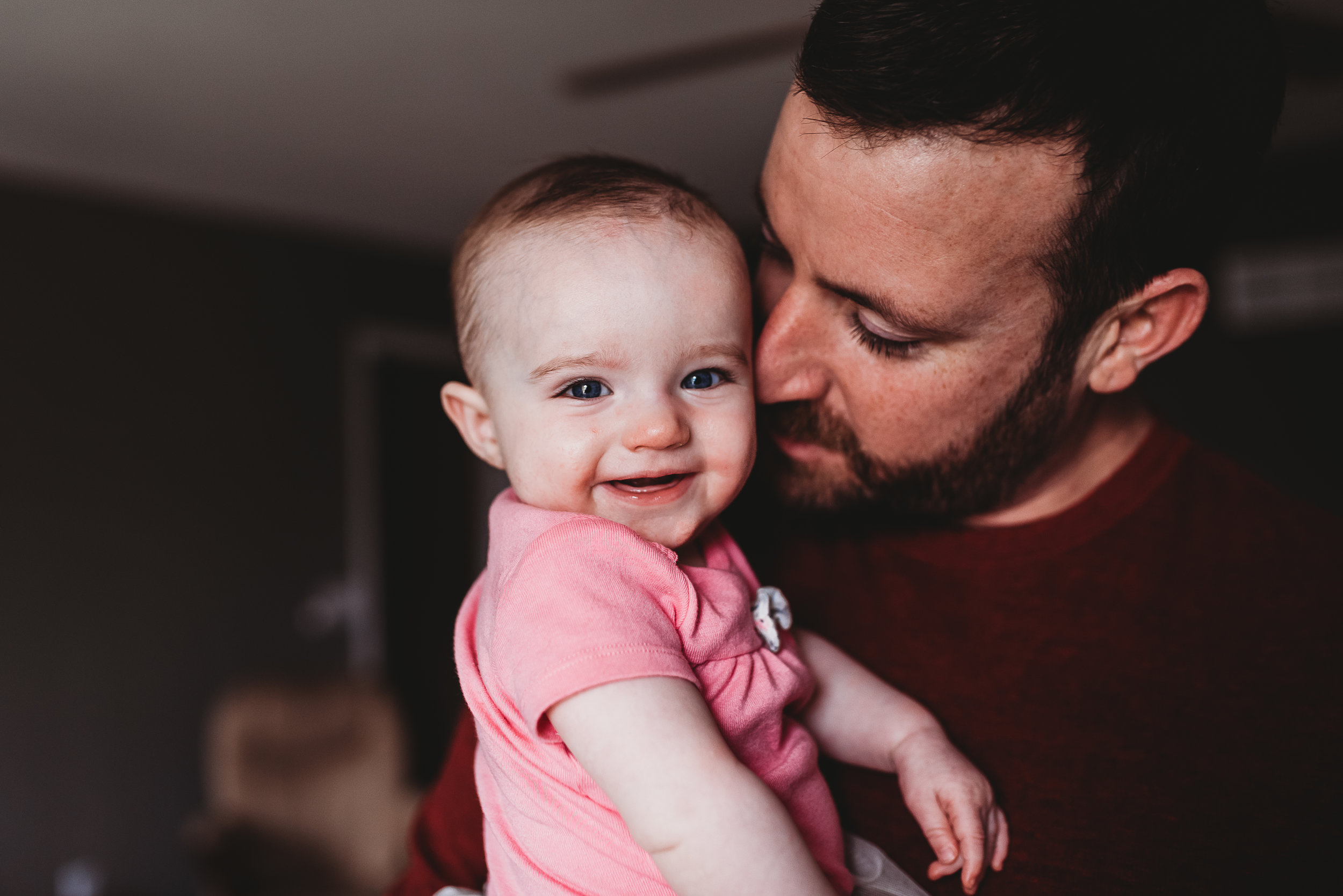 baby smiling with dad