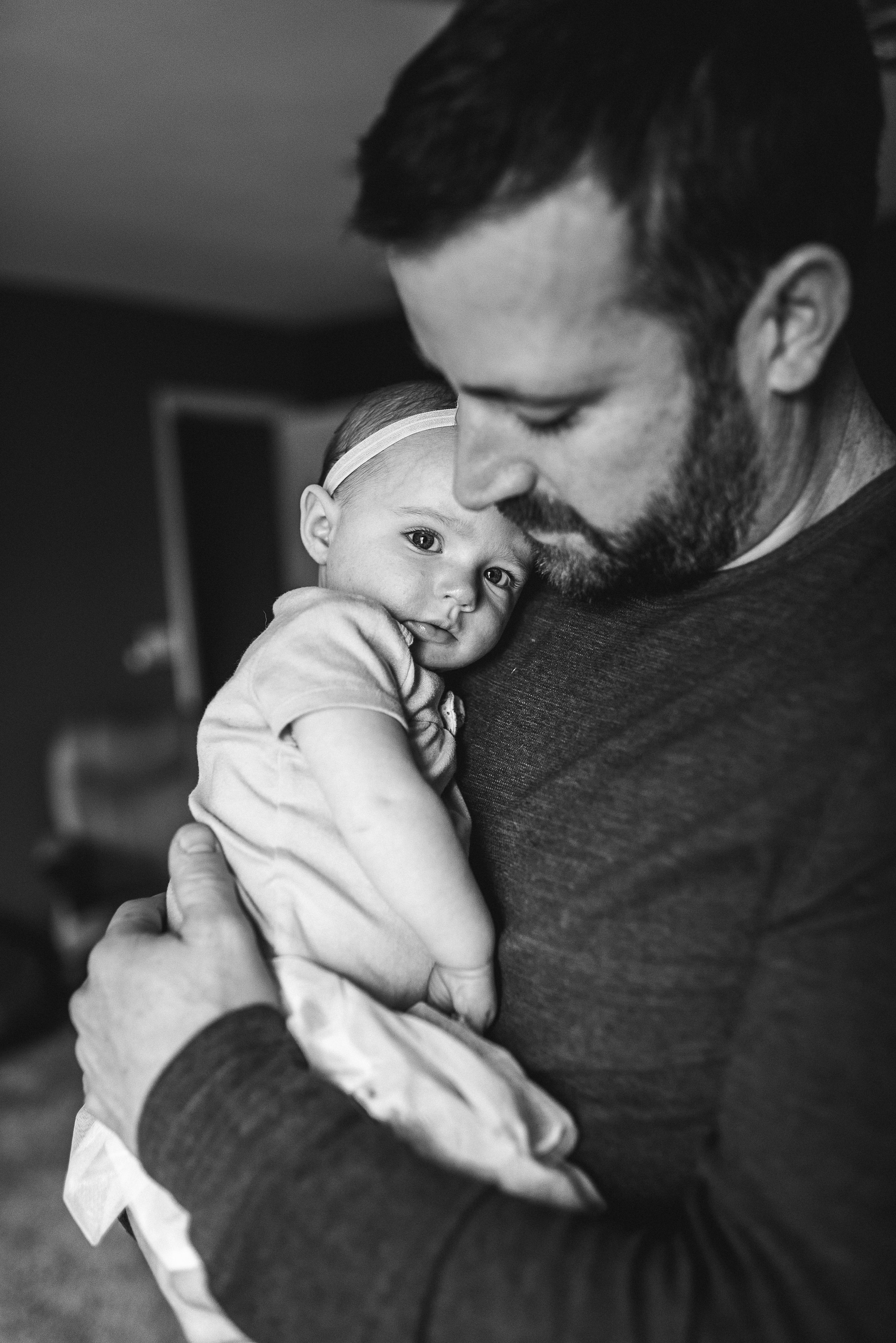 baby snuggling with dad