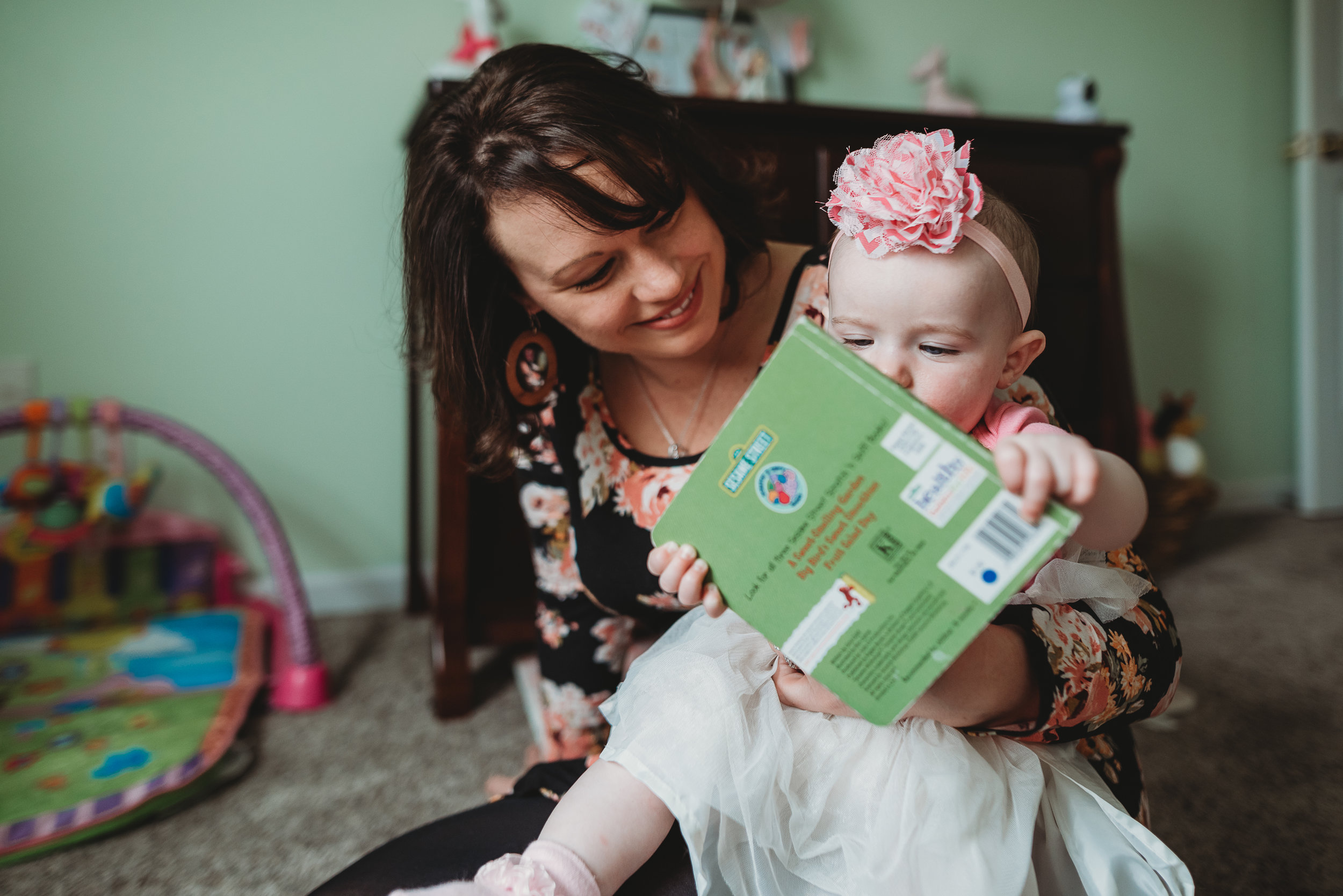mom reading book with baby