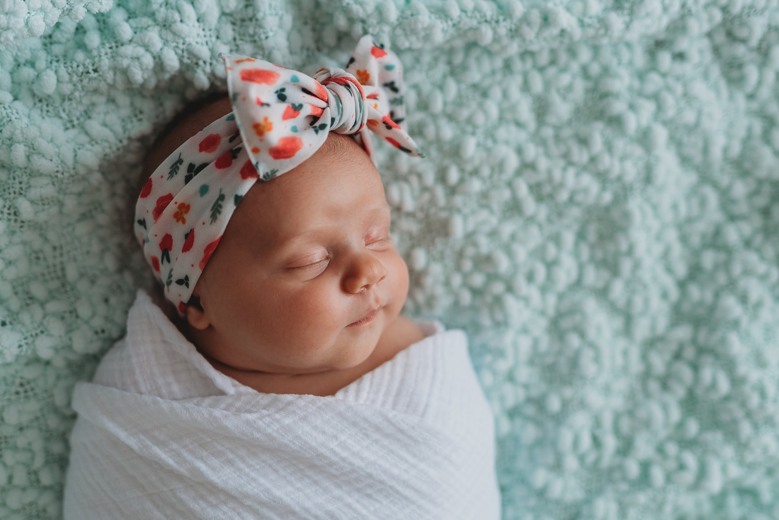 newborn girl on blanket