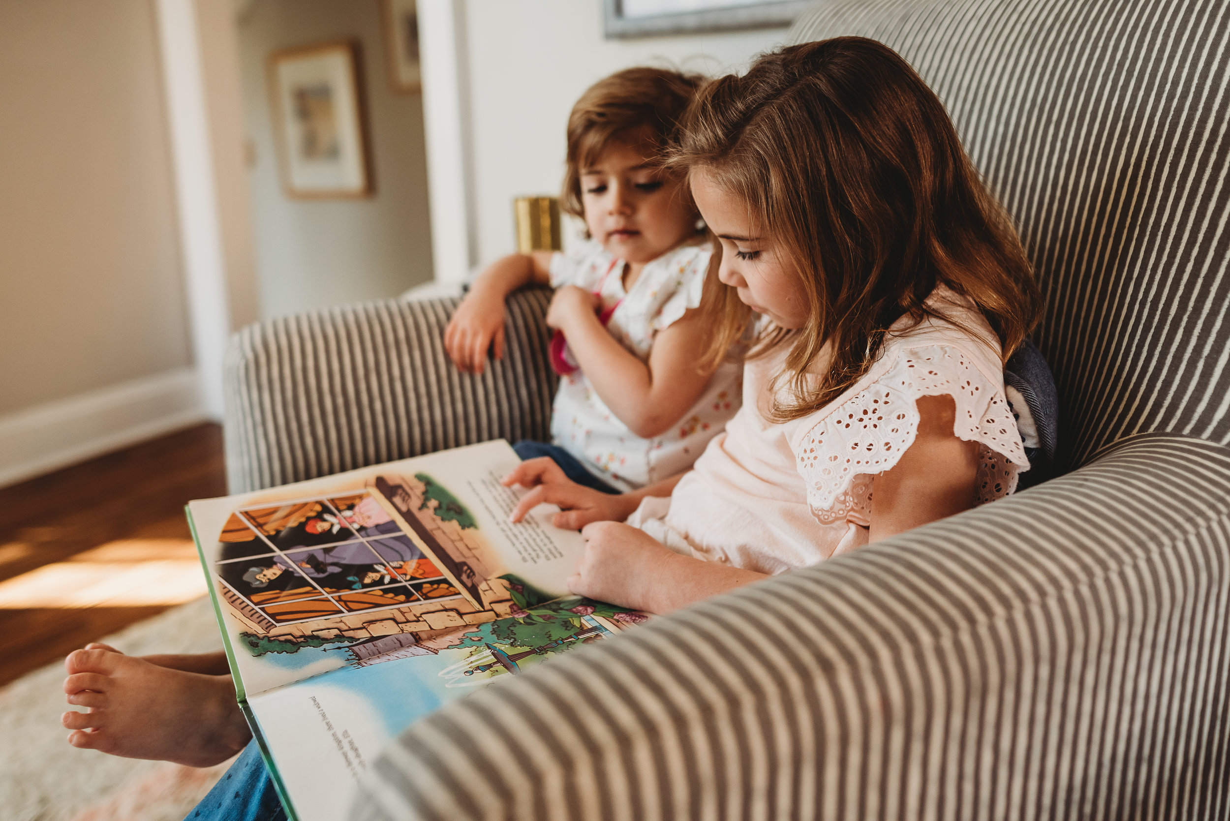 little girls looking at a book- St. Louis baby photographer