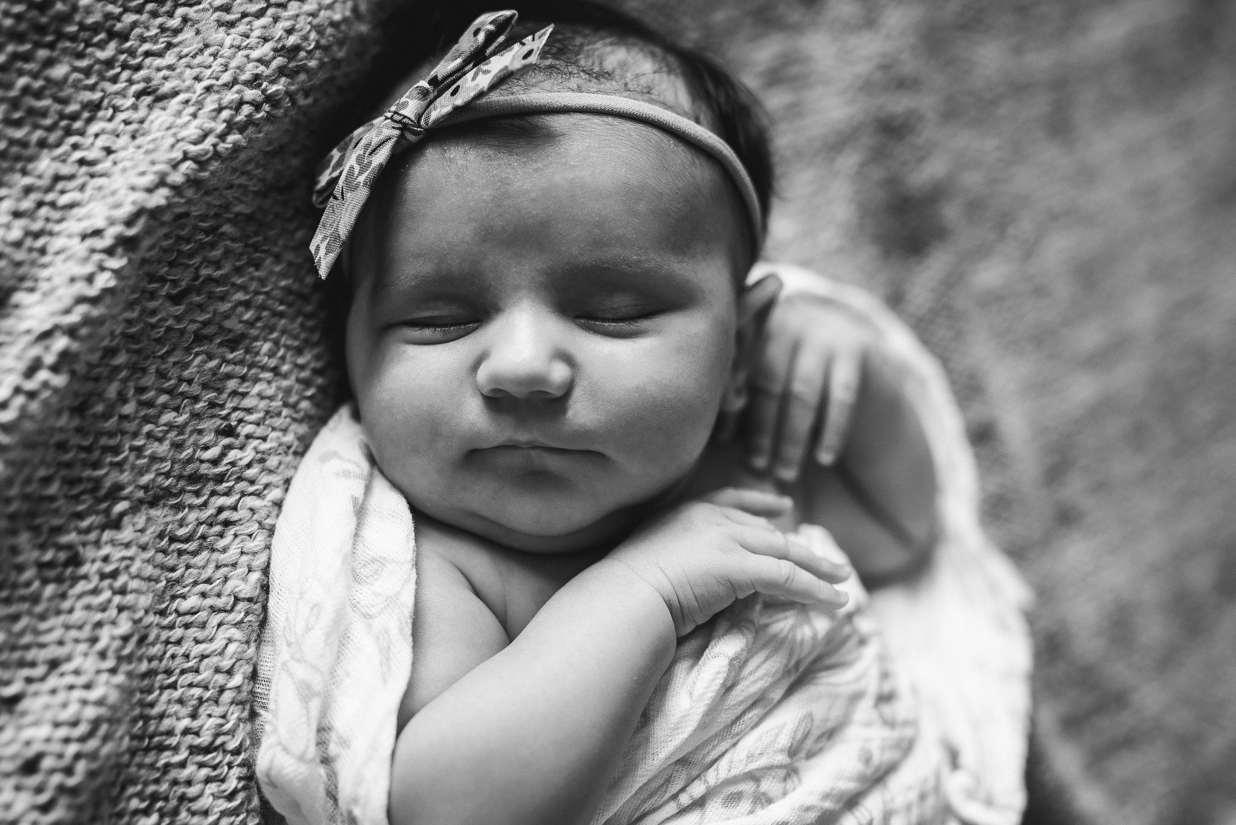 little baby girl sleeping on bed- St. Louis Family Photographer