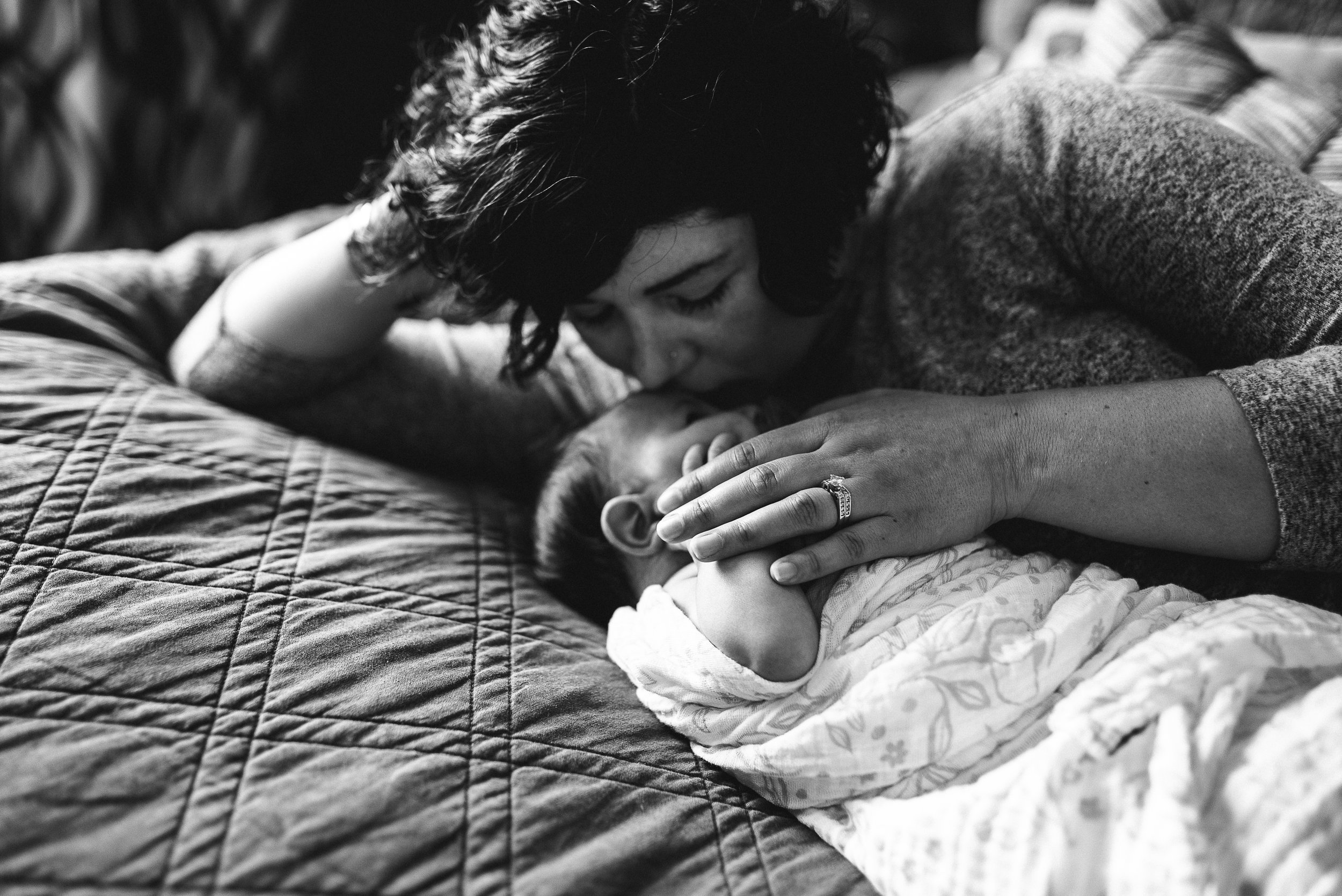 mom kissing newborn- St. Louis newborn photographer